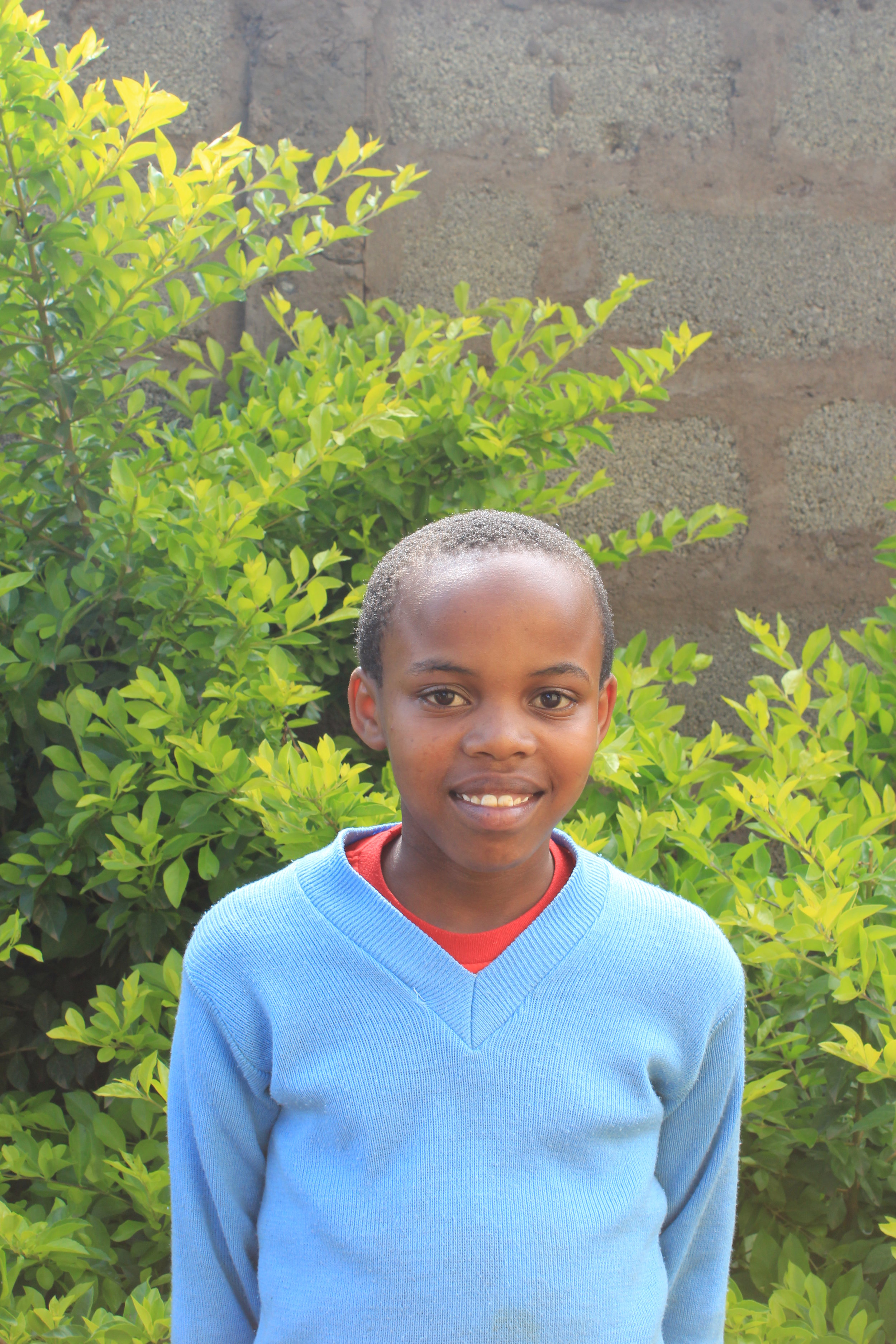 Irine, 12 - Irine's father died from Malaria. Her mother was traumatized after the death of her father and could not work or afford food for Irine. She was brought to Hope Center and her life has miraculously changed. She is thriving in school and loves to help cook in the kitchen!