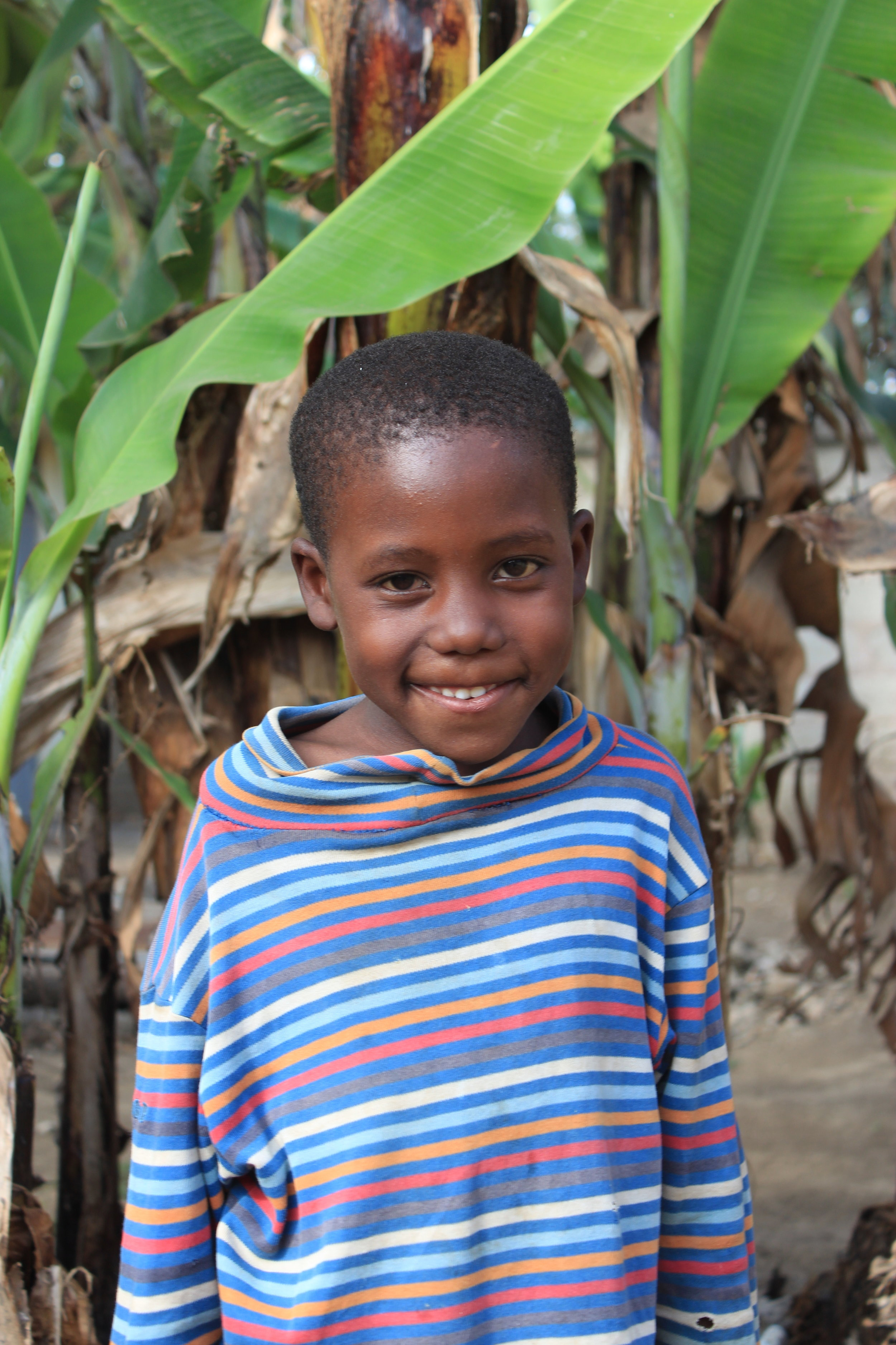 Moses, 6 - Moses is from a remote village in the interior of Tanzania. His mother passed away and his father became unable to care for him due to alcoholism and health issues. Moses came to Hope Center only able to speak his mother tongue. Now he is learning Swahili and English and is now enrolled in school thanks to one of our gracious supporters donations. He loves playing with all of his older brothers.