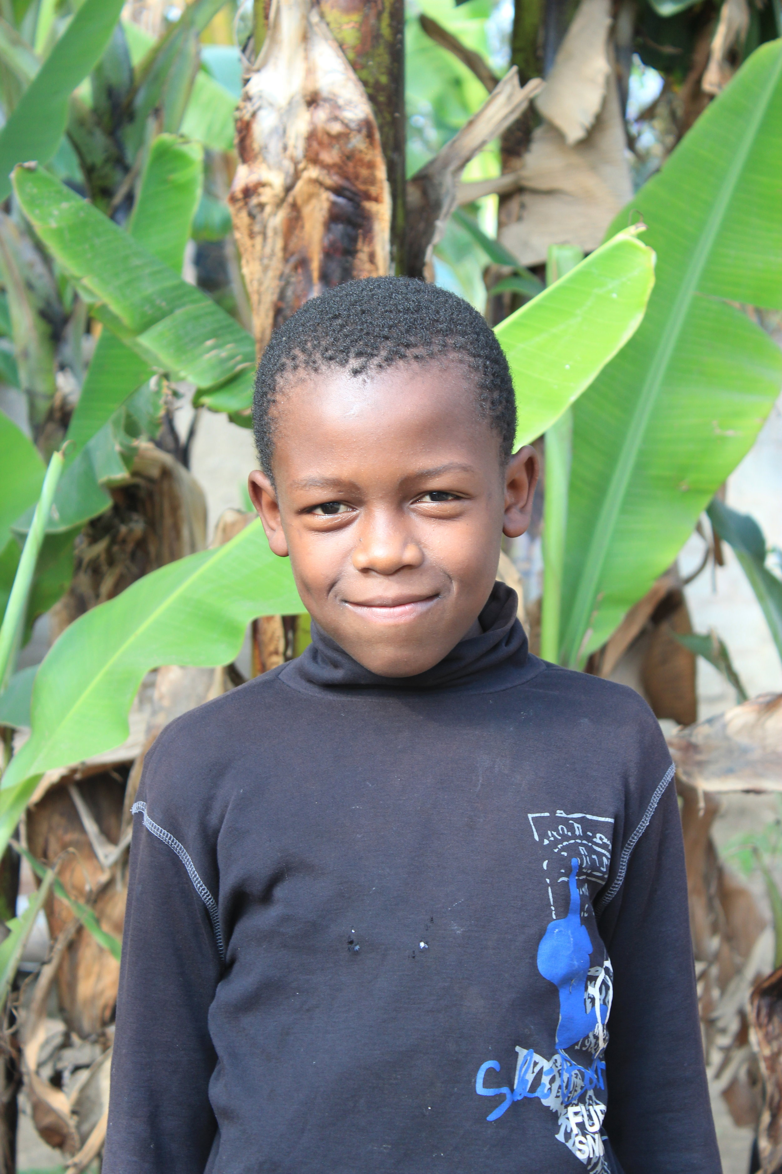 Joshua, 8 - Joshua's father died of HIV/AIDS and his mother is currently battling the disease and unable to care for him. Miraculously, Joshua is healthy and HIV/AIDS free! Joshua loves sports! He is always chasing a soccer ball and playing hard.