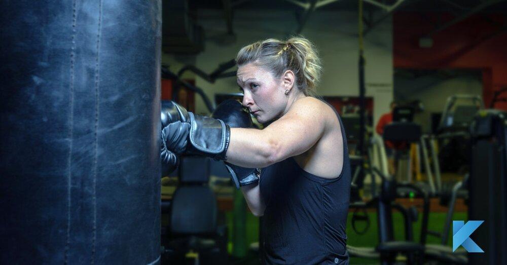 2019 2 6 girl boxing on punching bag klub athletik gym-min.jpg