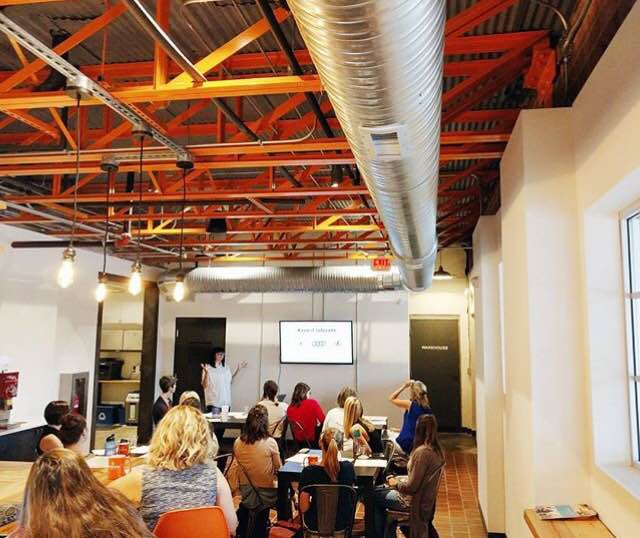 A room full of entrepreneurs learning from Sarah!