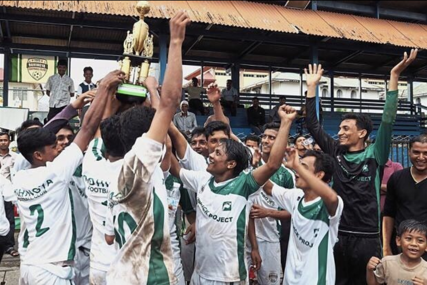 Sporting the custom made green and white uniforms made by Wooter Apparel, the Rohingya Football Club celebrates another victory competing in Malaysia's Kick Project.