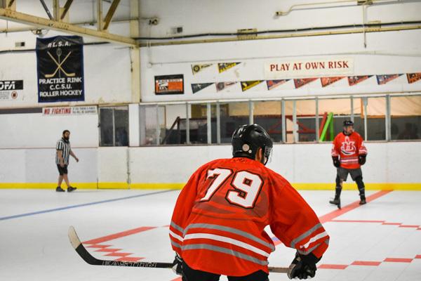Orange white and gray hockey jersey