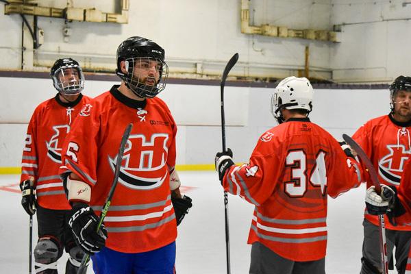 Orange black white and gray hockey uniform jersey