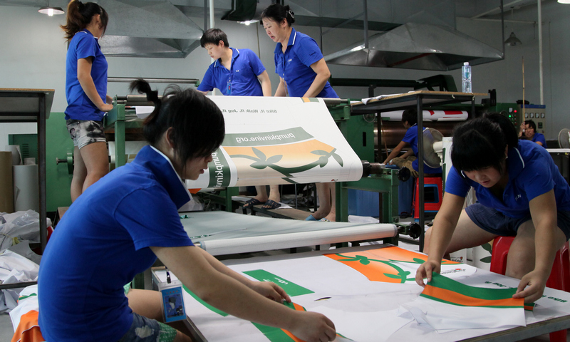 OUR TEMPLATE DESIGNERS ADJUSTING THE PRINTING PROCESS