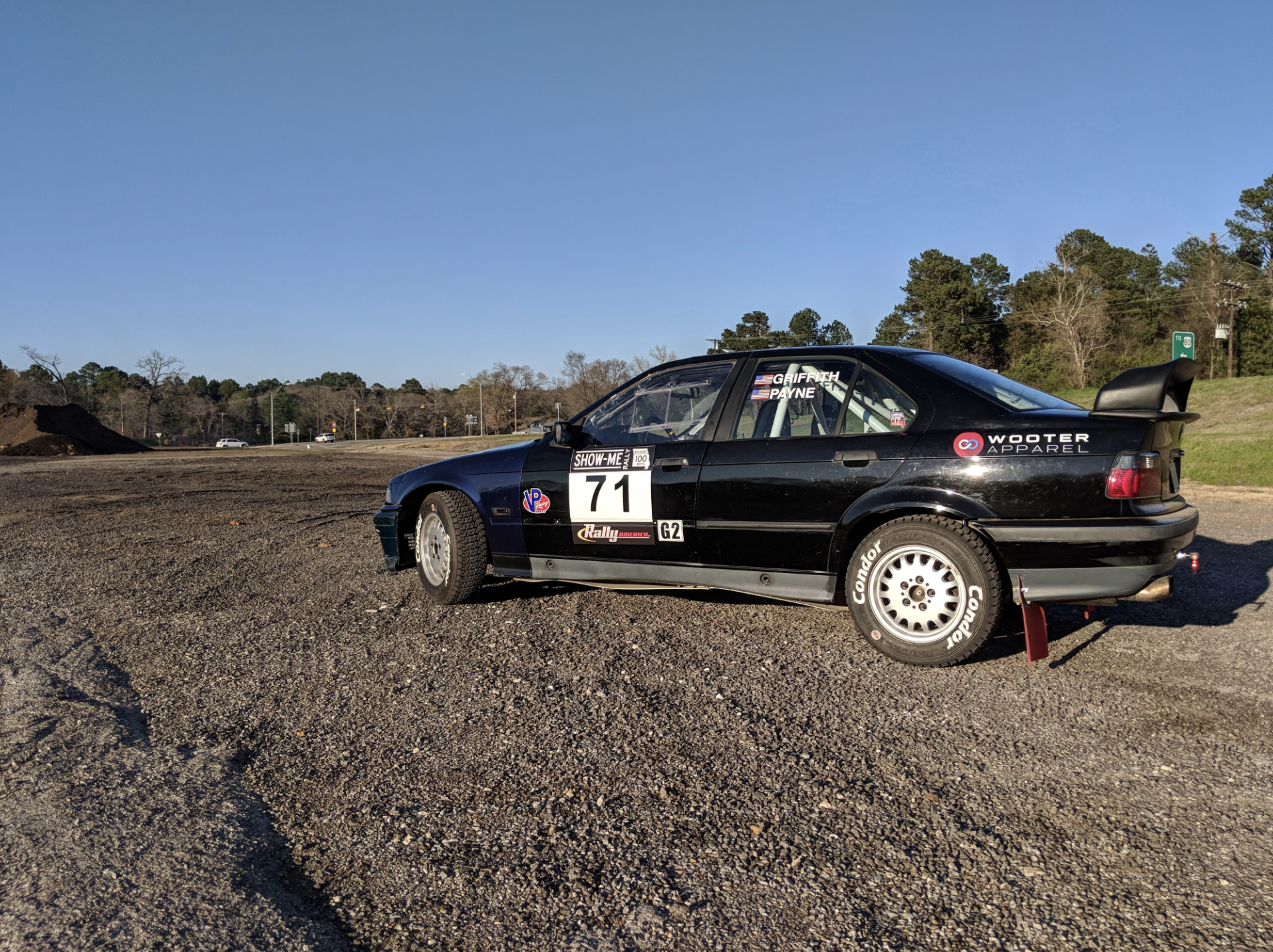 """Wooter Apparel is proud to be part of The Griffith Rally Team: """"I found this BMW for $600, non-running, and committed to it....Having Wooter Apparel as a sponsor is fantastic, as it gives each person on the team a sense of being part of the family."""" - -Garrett Griffith"""