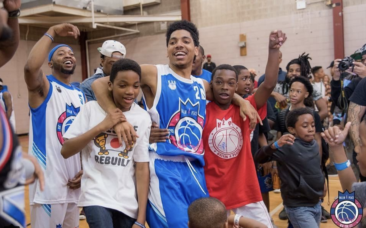 """Back To Back: Last year Wooter Apparel began teaming-up with Haron """"H20""""Hargrave and his community give-back event in Queens, New York by designing these classic red, white, and blue uniforms. Is there a three-peat in the future?"""