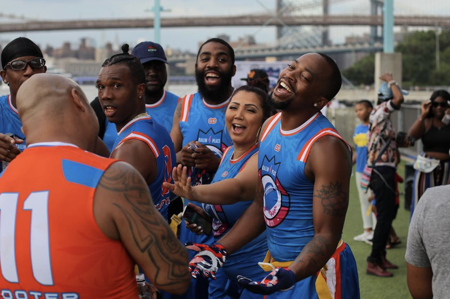 """Peep The Crossover: The 4th Annual Ballin' 4 Peace Celebrity Flag Football Game at Brooklyn Bridge Park in Early August was another Successful Give Back Event for founder and creator Haron """"H20"""" Hargrave, who turned to Wooter Apparel this year to collaborate on some fresh customized football jerseys."""