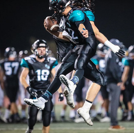 Each year Wooter Apparel works with a number of high school football teams around the US to customize their gear for the season. This year we are proud to cheer on Aliso Niguel High School in Aliso Viejo, California, with the Wolverines donning the teal and black from Wooter Apparel this Fall.