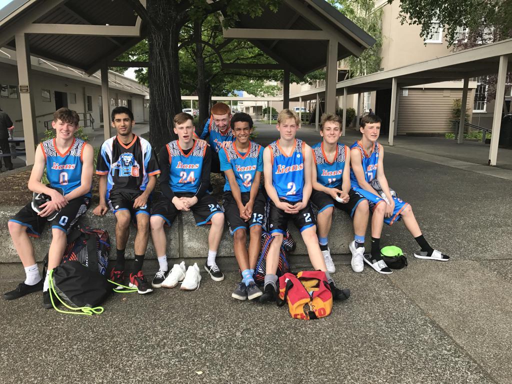 Youth LIONS Blue Black Orange White basketball uniforms, jerseys, and shorts