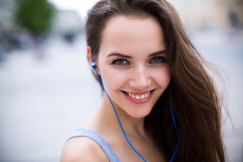 Beautiful woman having a perfect listening experience on her headphones using Headphone Magic