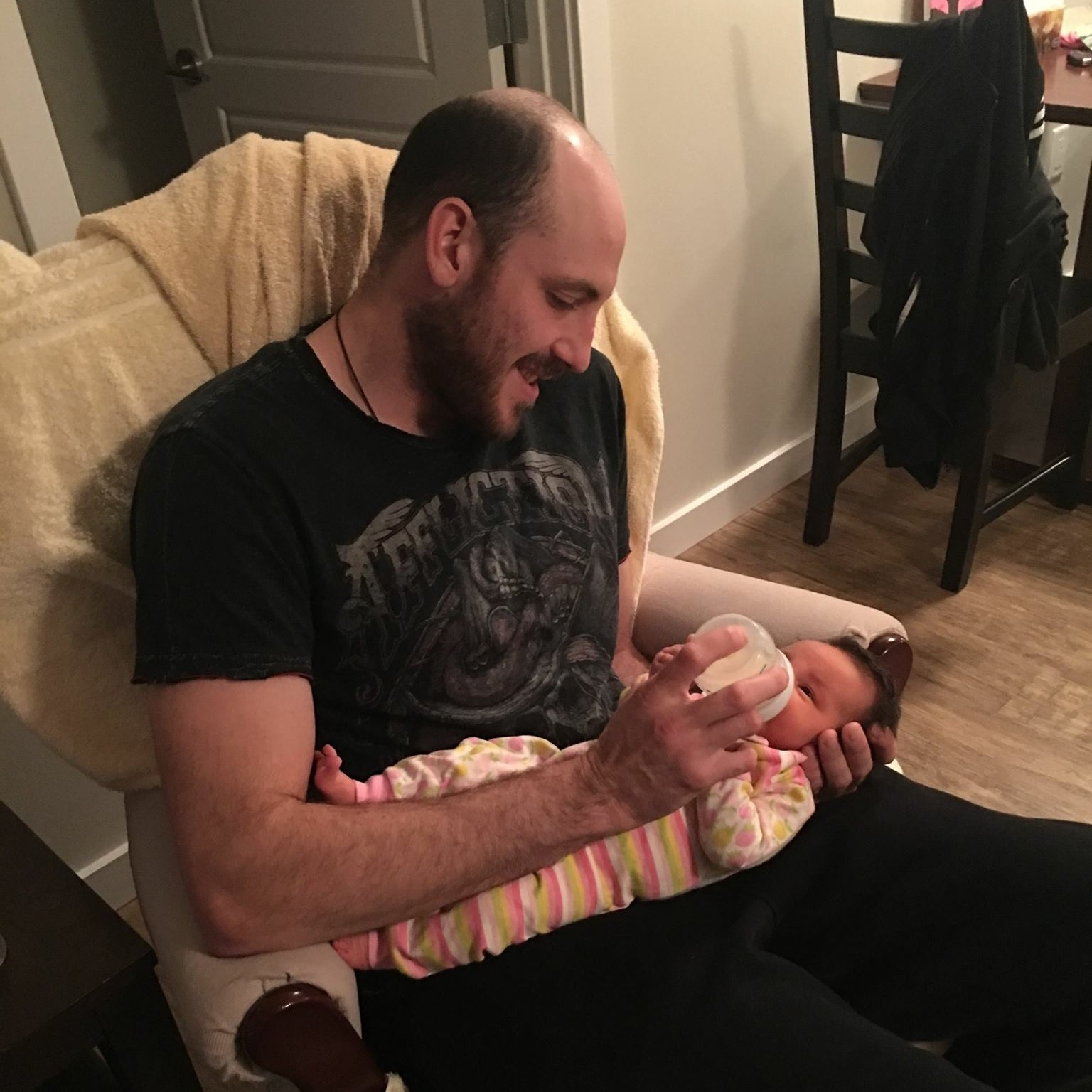 Todd Chambers holding his infant daugher Hayden Julia