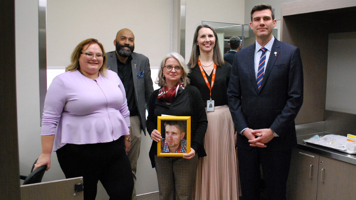Alberta Health Minister Sarah Hoffman, left, MLA David Shepherd, Moms Stop the Harm co-founder Petra Schulz, Dr. Kathryn Dong of the Royal Alexandra Hospital (RAH) and Edmonton Mayor Don Iveson open the RAH's Supervised Consumption Service, the first hospital-based service of its kind in North America. Schulz holds a portrait of her son Danny, who died of an accidental Fentanyl overdose in 2014. Photo by AHS.
