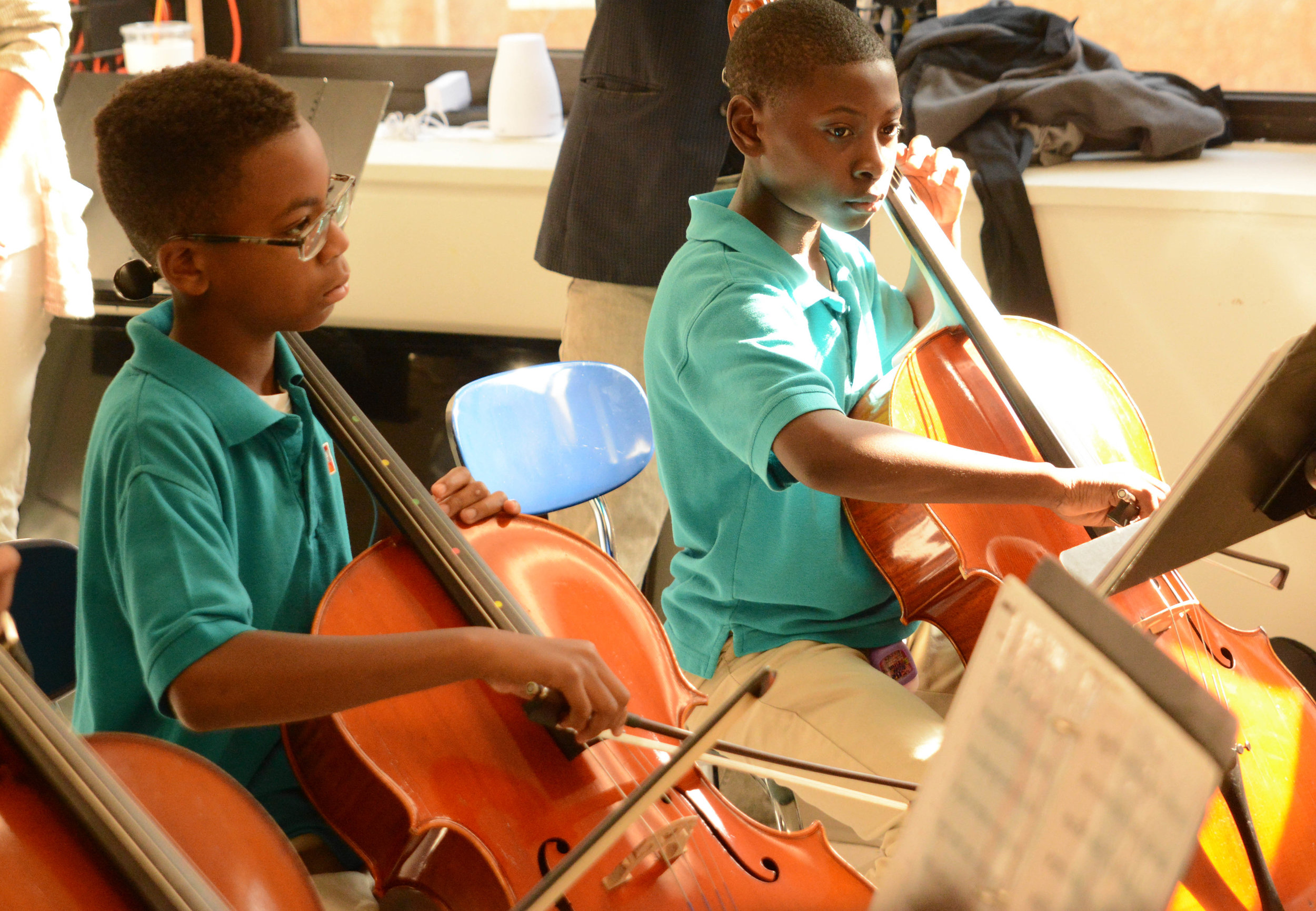 """6th graders in the Abbado string orchestra concentrate play """"Ride of the Valkyries."""""""