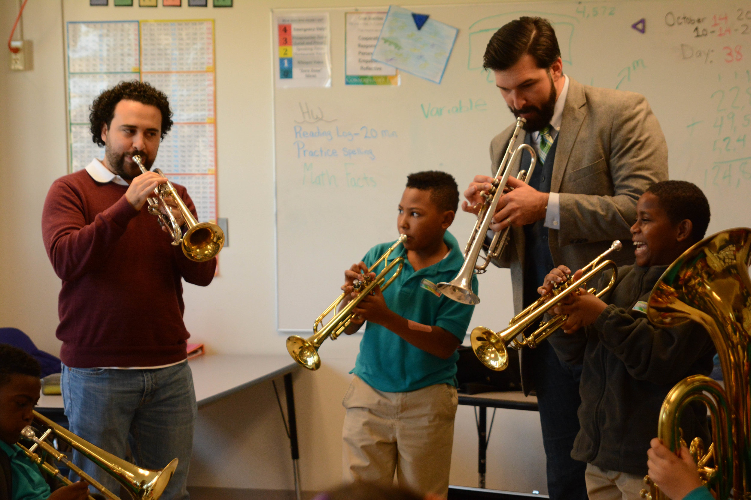 5th grade brass students play with Andres Gonzalez, principal trumpet of the Simón Bolívar Orchestra.