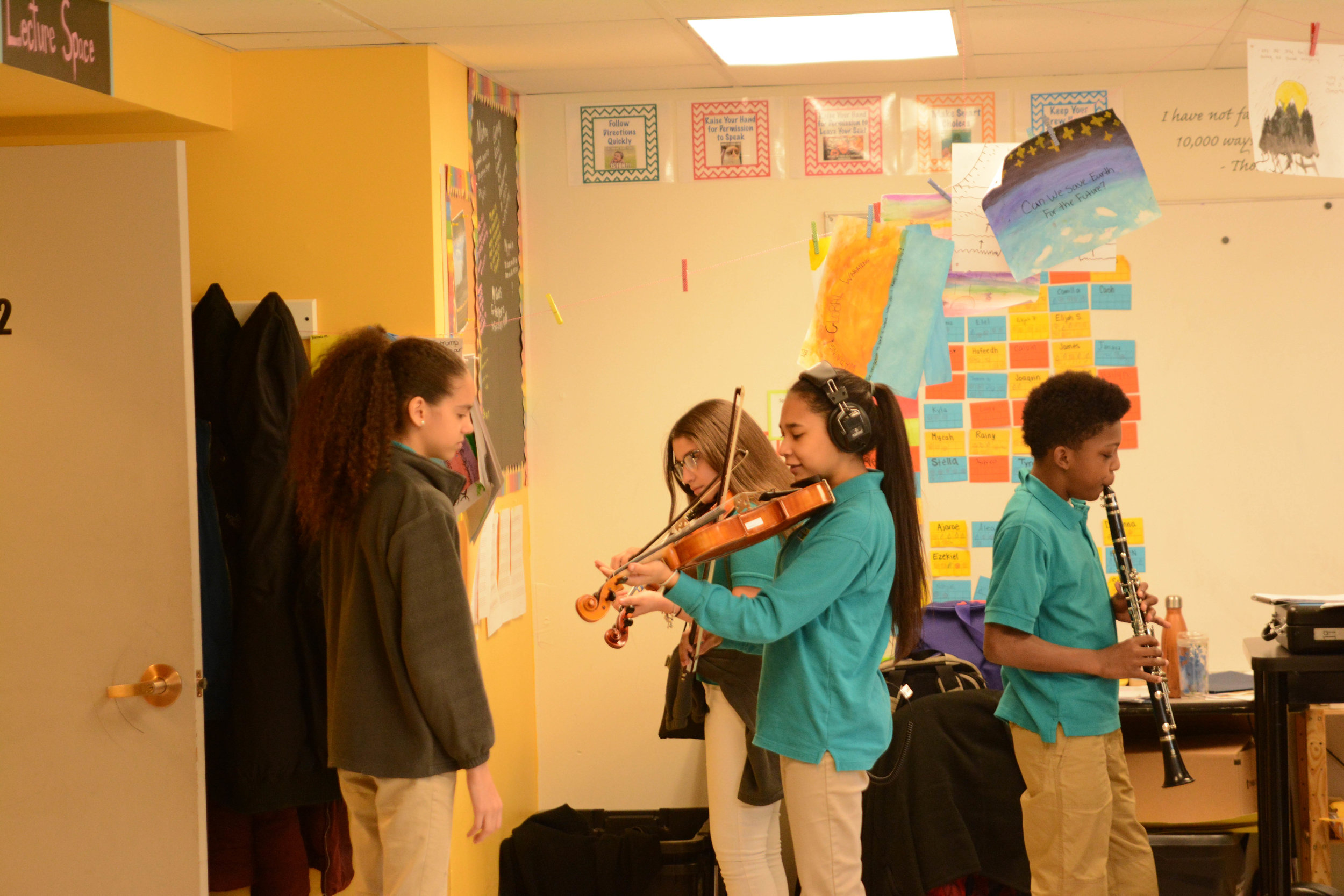 Students practicing their self-composed pieces.