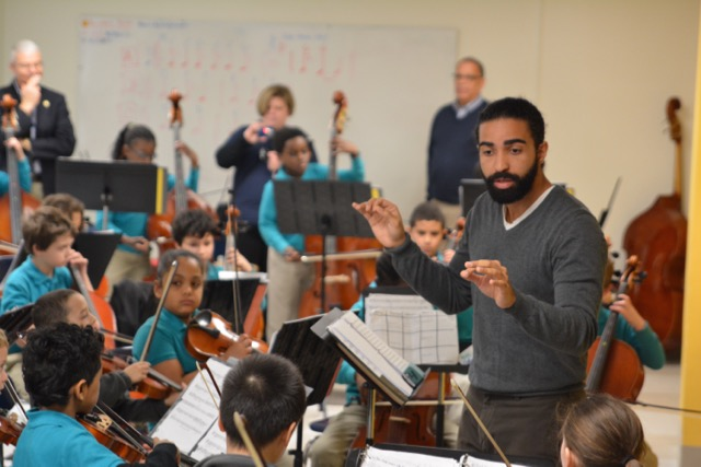 Josue leads an ensemble during practice time.