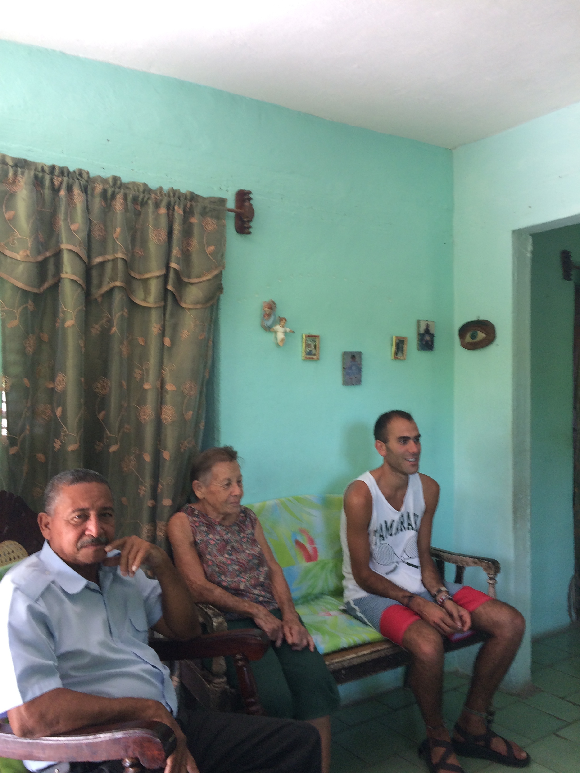 Members of Margarita's family, and my son (far right), watch the film.