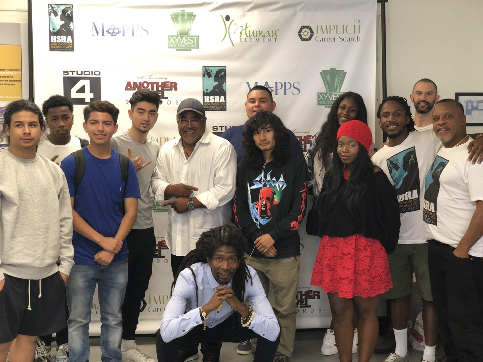 """Students and staff of HSRA LA with the founder of HSRA MN - David """"TC"""" Ellis (far right) - and former NFL player/sound engineer Dave Hayes (center)."""