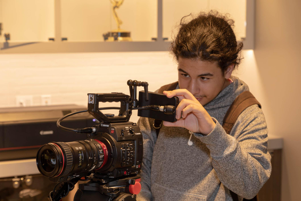 A student of HSRA LA at the Canon Burbank studio for a field trip focused on the photo/video components of the recording industry.