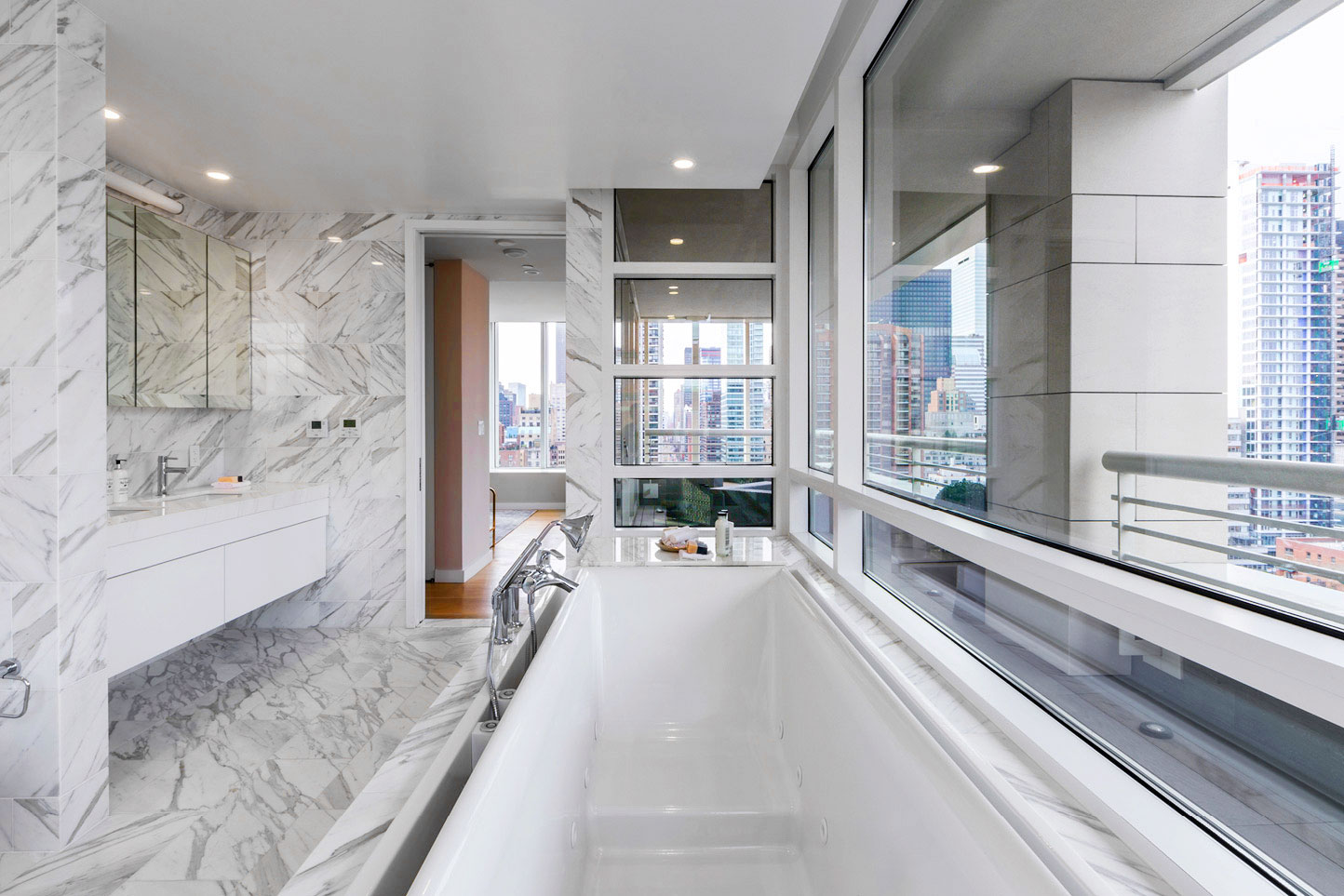 Time To Relax - For the penthouse master bathroom we sourced, custom fabricated and installed fine Italian Calacatta Gold marble slabs throughout. And, in The Clare's remaining 65 luxury bathrooms we installed custom quartz vanity countertops with complimentary porcelain floor and wall tiles.