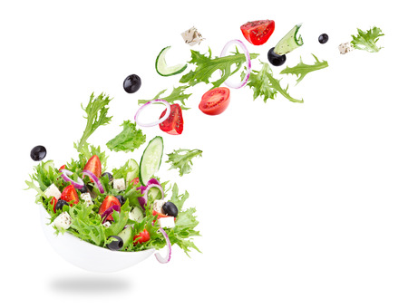 40829154 - fresh salad with flying vegetables ingredients isolated on a white background.