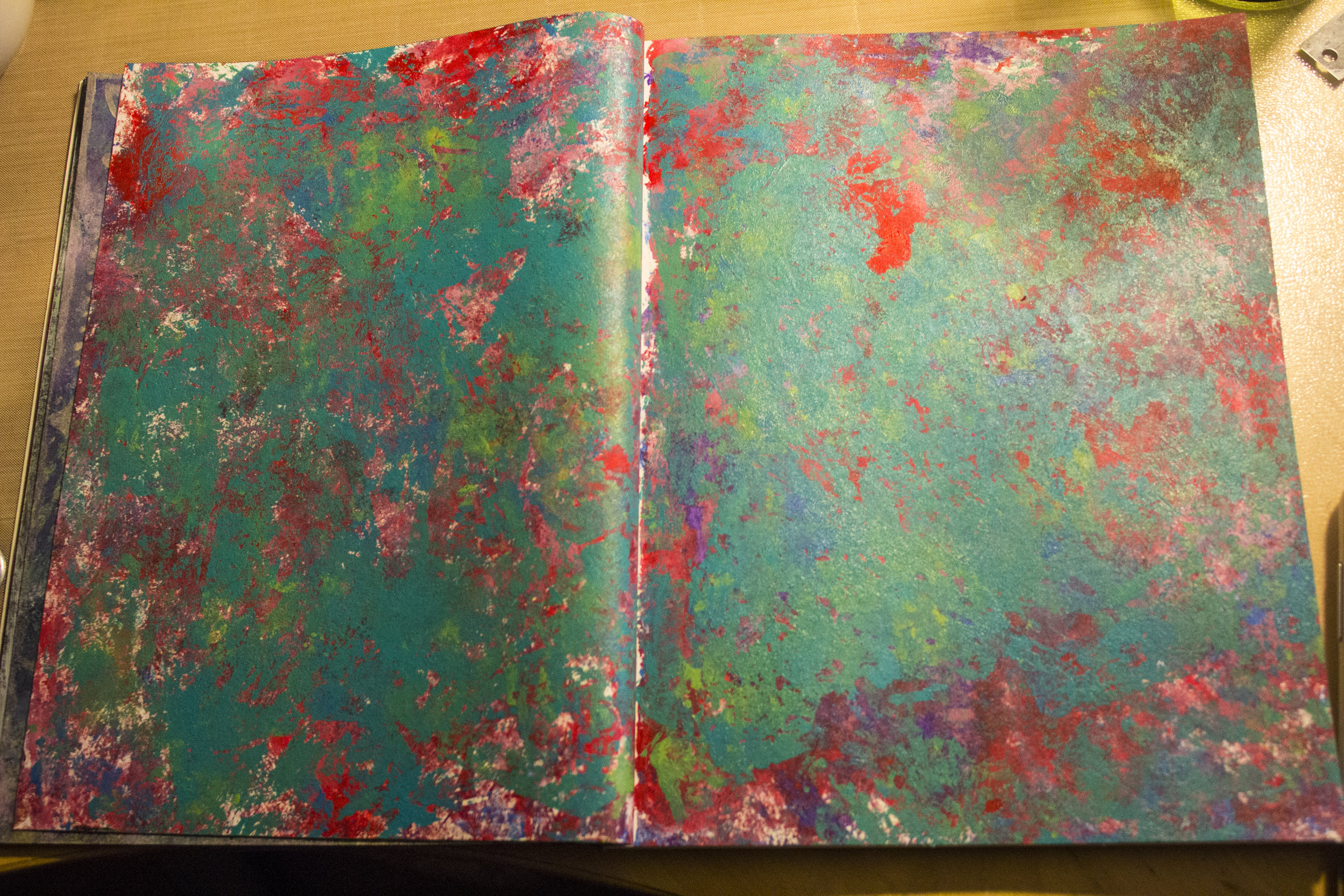 I first kept reapplying the cling wrap to cover the page, then after doing another page, used the cling wrap from that on top of this one. It really makes that red POP!