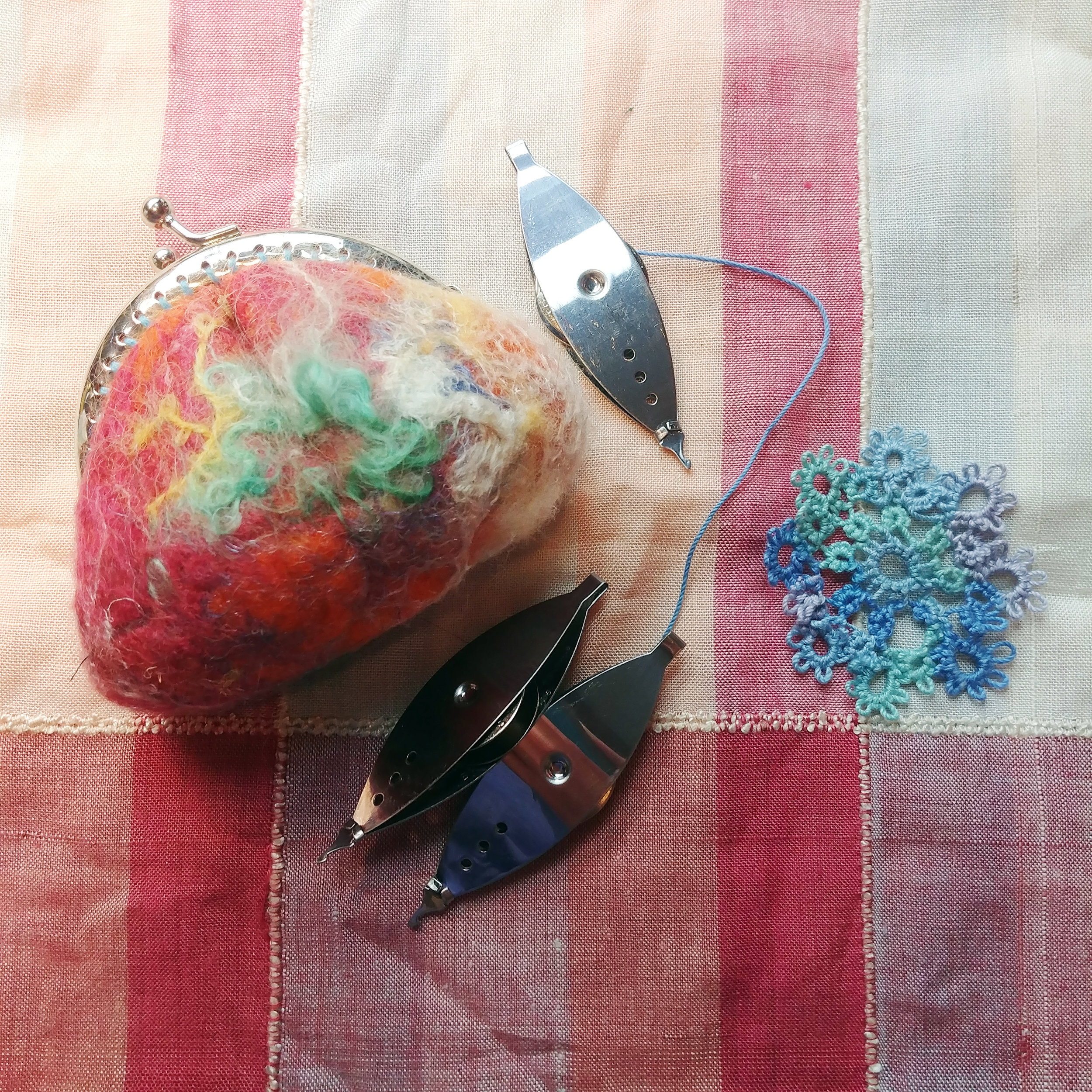 This adorable felted coin purse fits my three tatting shuttles and a small project, such as the medallion I made.