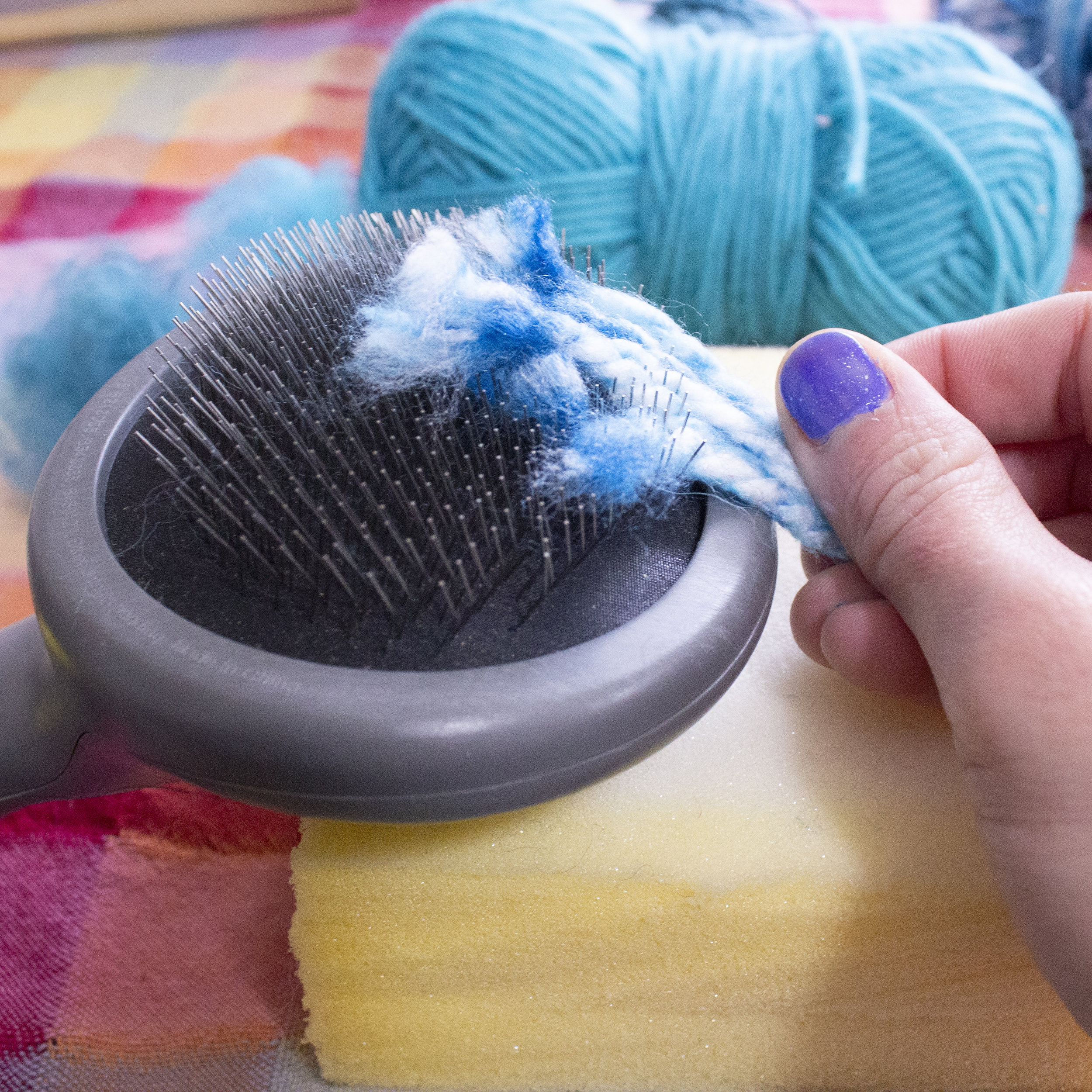 Pulling the fiber by hand against a dog brush.