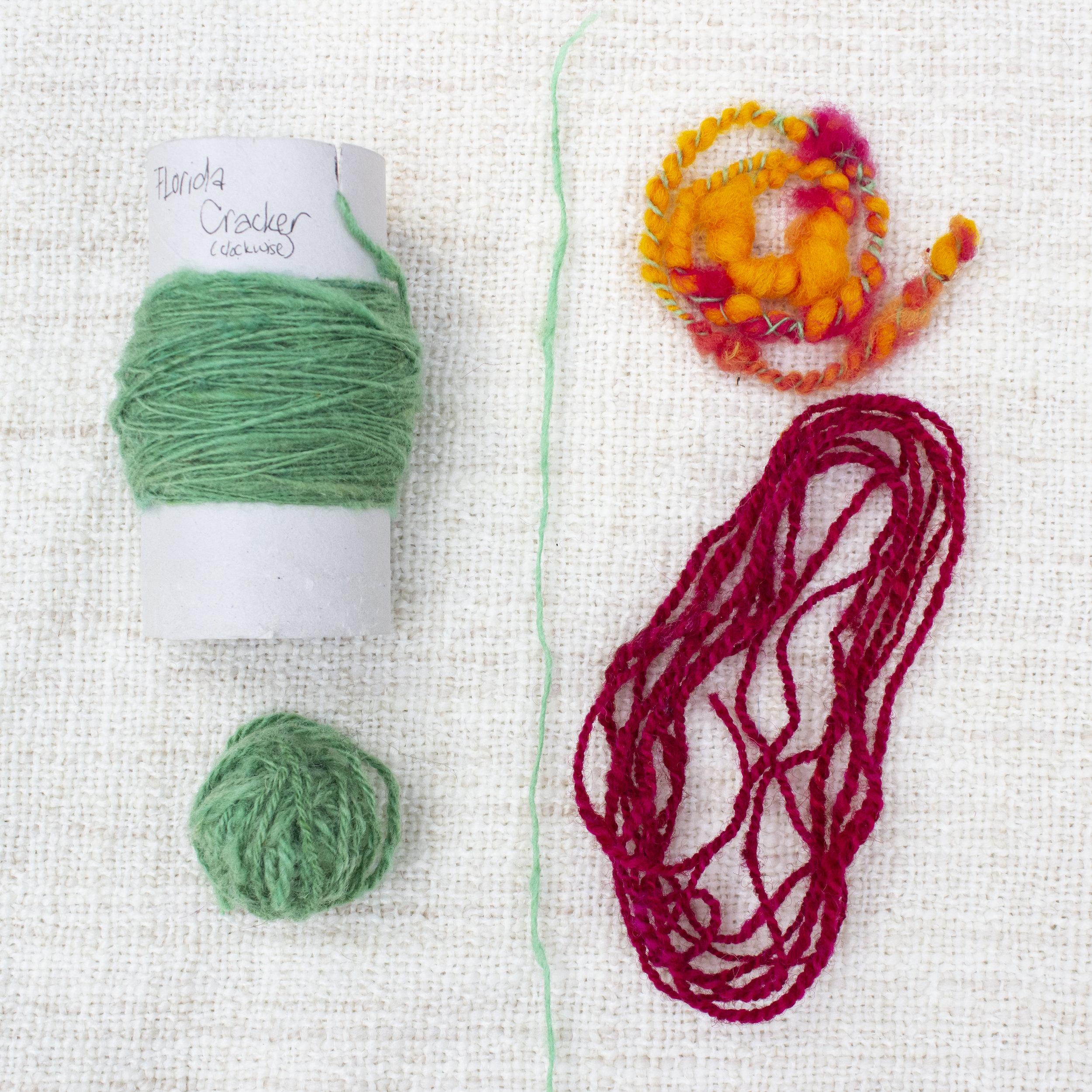 Various spun yarns - single, poofy thick & thin art yarn, 2-ply red, navajo (chain) plied green
