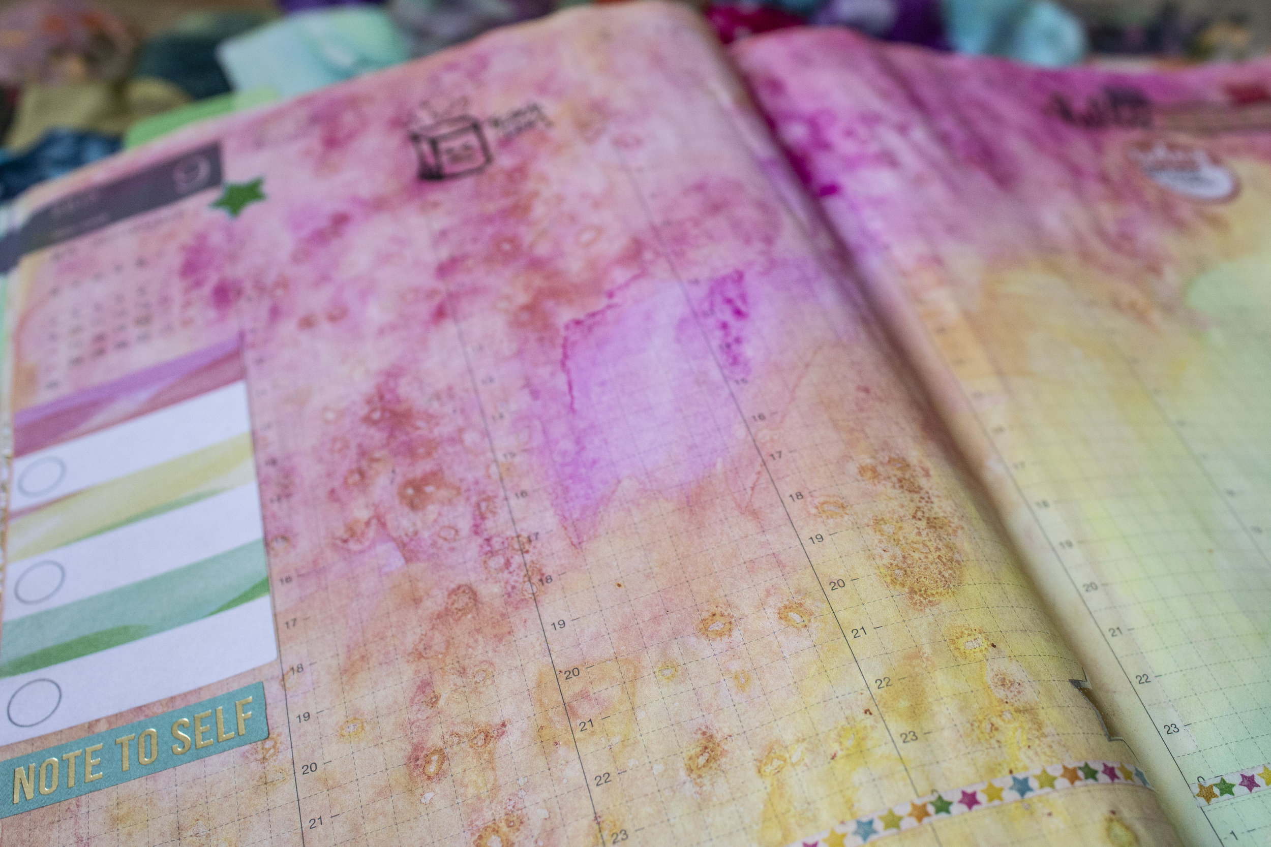 """This is what people in the planner world call """"before the pen"""" - trust me, all these pages are filled. I just don't want to share that on here, lol. I do love to make colorful backgrounds and add stickers before I start filling it out and doodling."""