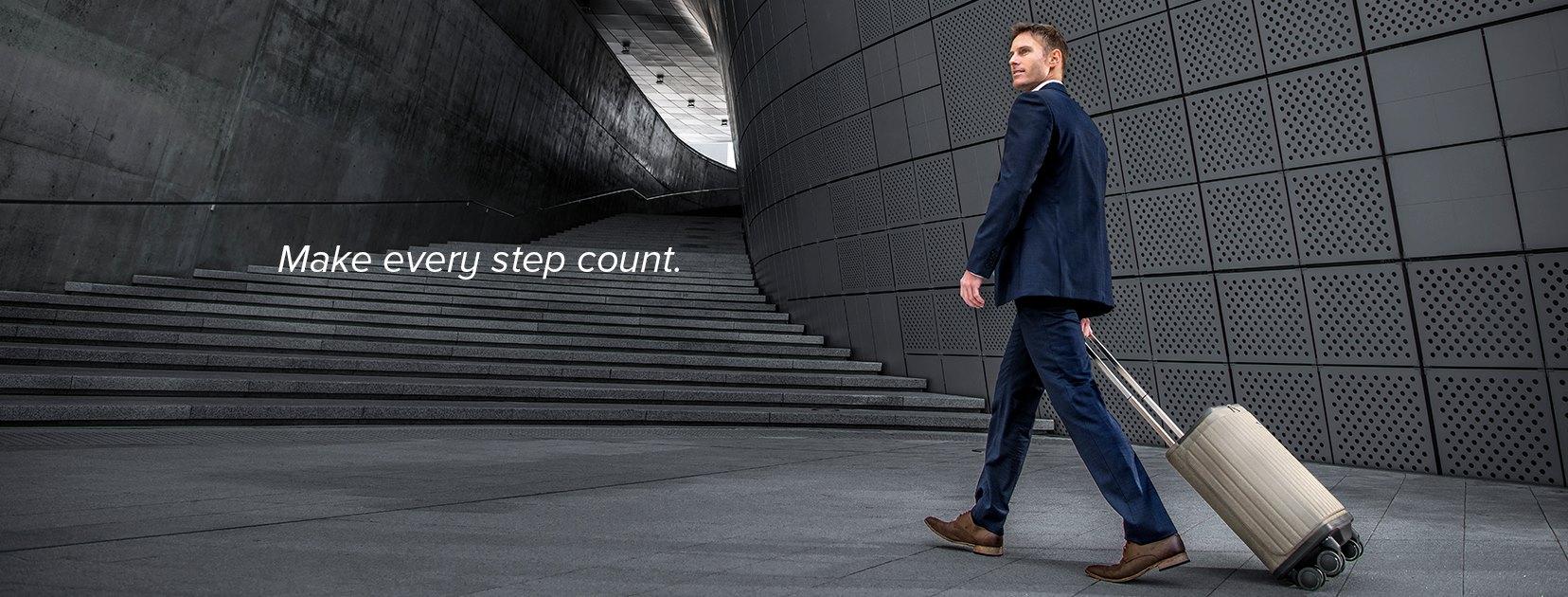 Rollogo-Escape-smart-luggage-mobile-office-business-man-walking.jpg