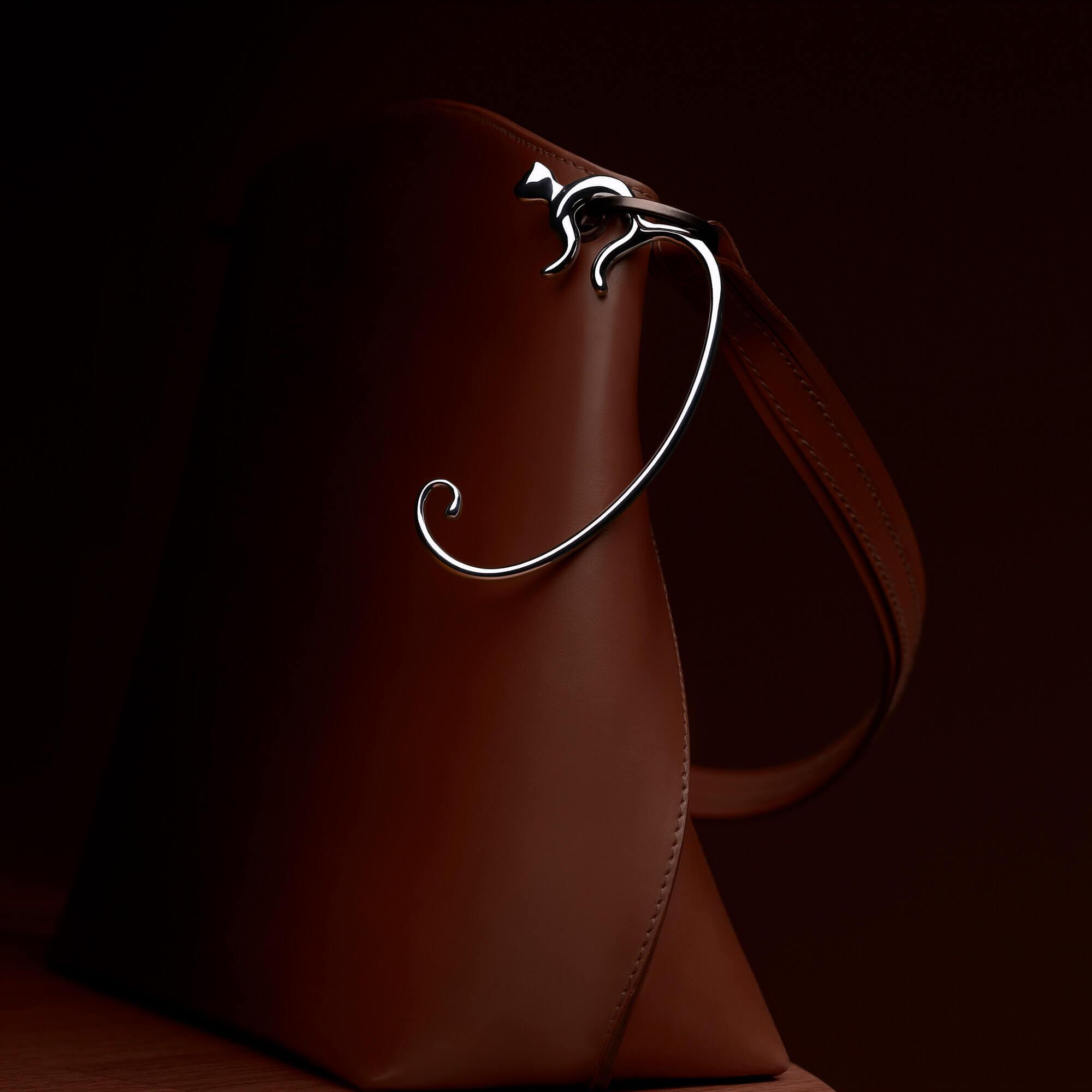 Minou, the bag hook for Alessi