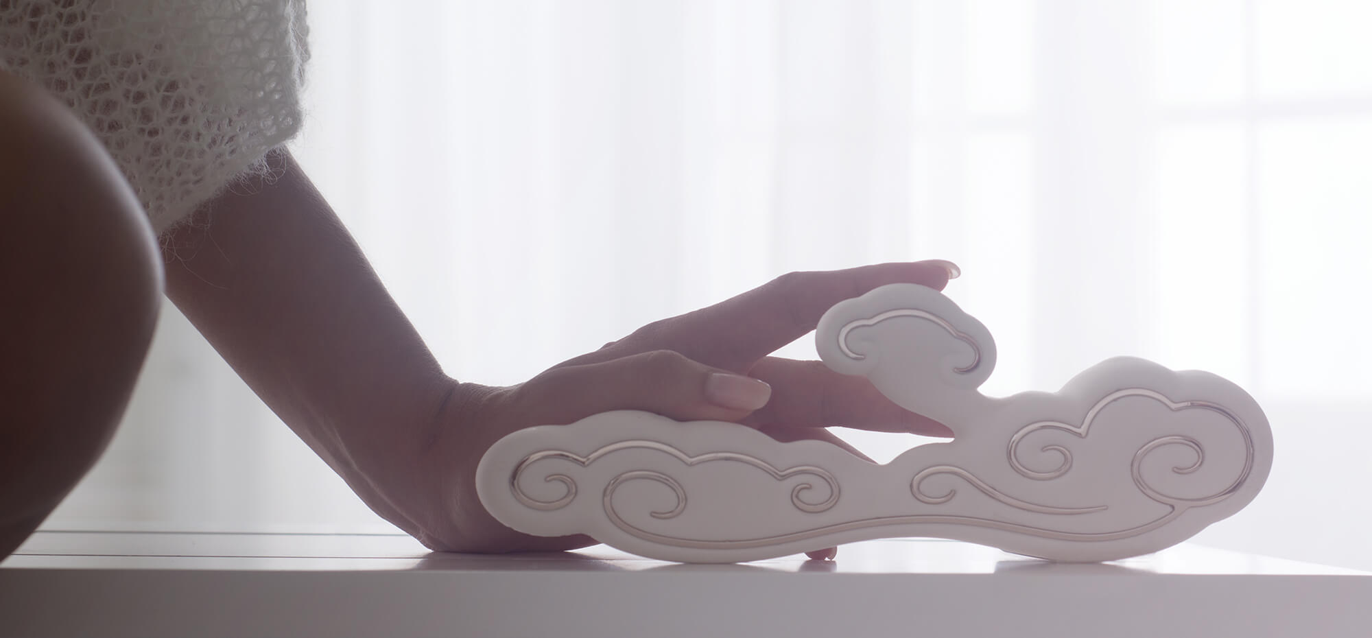 Ave-Sky- sensual-woman-holding-cloud-adult-toy.jpg