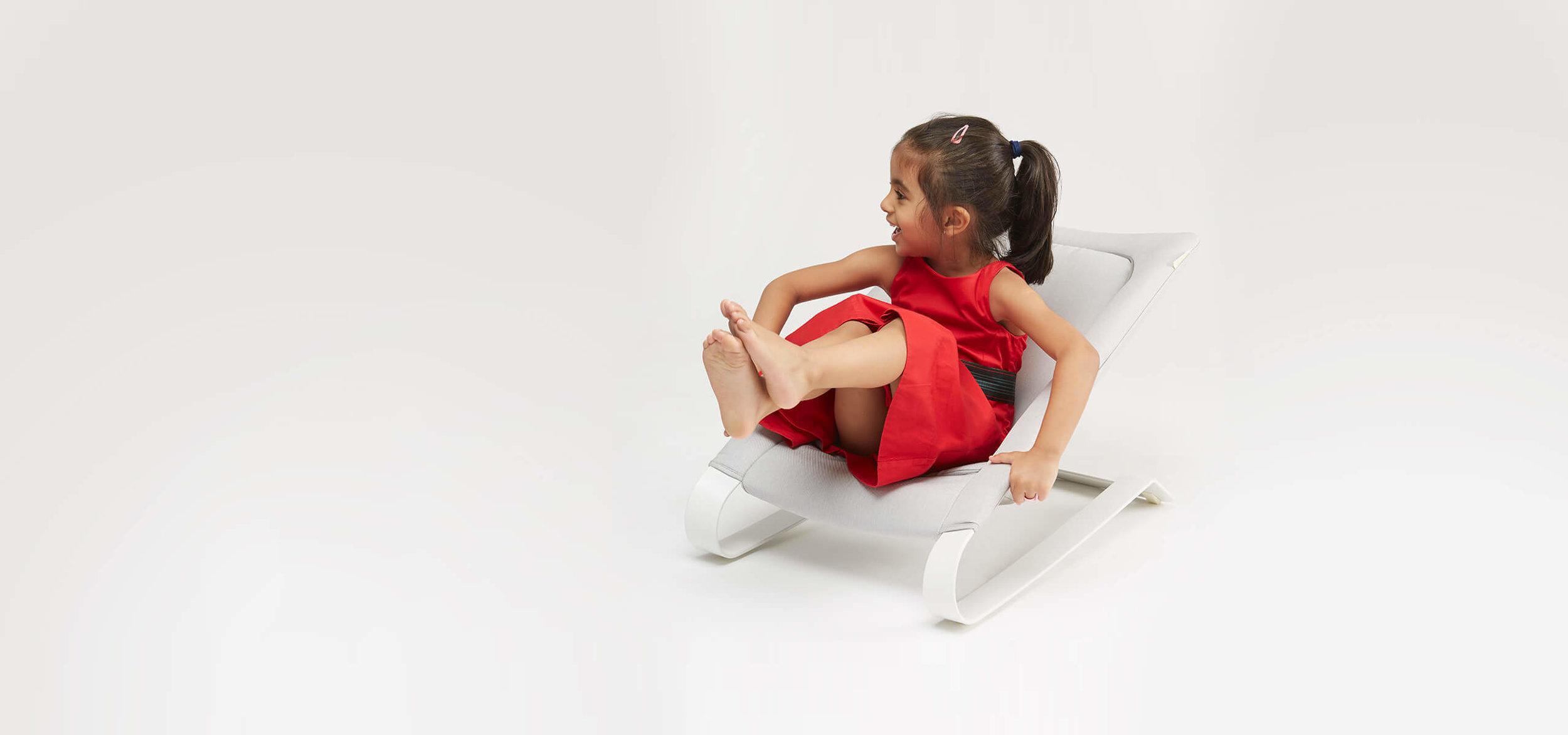 Bombol-Bamboo-big-girl-in-red-in baby-bouncer.jpg