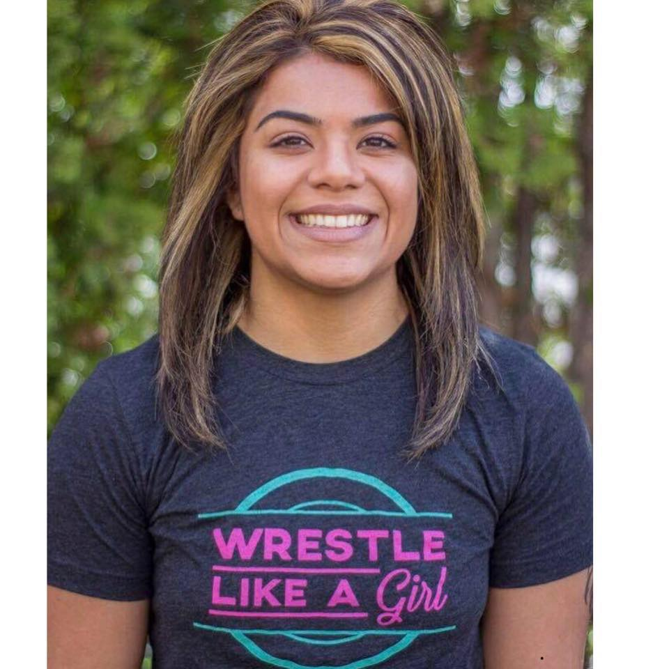 """Axa Molina - State Sanctioning Manager - Axa Molina Hired As State Sanctioning Manager - Wrestle Like A Girl, Inc.March 22, 2018COLORADO SPRINGS, CO — Wrestle Like A Girl, Inc. hired Axa Molina as the State Sanctioning Manager. She will be working with USA Wrestling's State Sanctioning Task Force and each of the remaining 42 unsanctioned states to get more Girls High School Wrestling Divisions established. Female wrestling in the United States is one of the fastest growing sports. Wrestle Like A Girl is committed to helping the growth so that our girls and women wrestlers get the opportunities they deserve.Axa is originally from Federal Way, WA, where she started wrestling her sophomore year of high school. She was a multi-time state placer before she accepted a wrestling scholarship to Lindenwood University in St. Charles, Missouri. While at Lindenwood, she served as a captain and earned All-American honors, including qualifying and competing at the Rio 2016 Olympic Trials. In 2016, she graduated from the Lindenwood University earning a Bachelor's of Science in Athletic Training and a minor in nutrition.Axa participated in the Miss Seafair Scholarship program for women as the Hispanic Seafair community representative and earning the coveted Seattle title of Miss Seafair. Axa's community service platform was Wrestle Like a Girl where she continues to create awareness of women's wrestling in the greater Seattle area and the Latino community of Washington state. Through the Miss Seafair program, she also earned the community service award for her dedication to growing girls' wrestling and was most notably quoted for saying: """"Wrestling is not just done on the mat. We wrestle every day to balance our work life and our family life. We wrestle to work for studies and obtain our degrees. Or, if you are like me, you wrestle with the voice that whispers 'I can't'. Today, I stand before you as a confident young woman and a testament to what wrestling can do for a girl. Not on"""