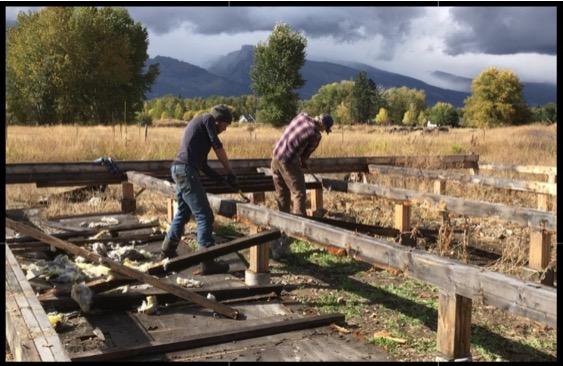 Noah and Greg do demolition work for the yurt platform.