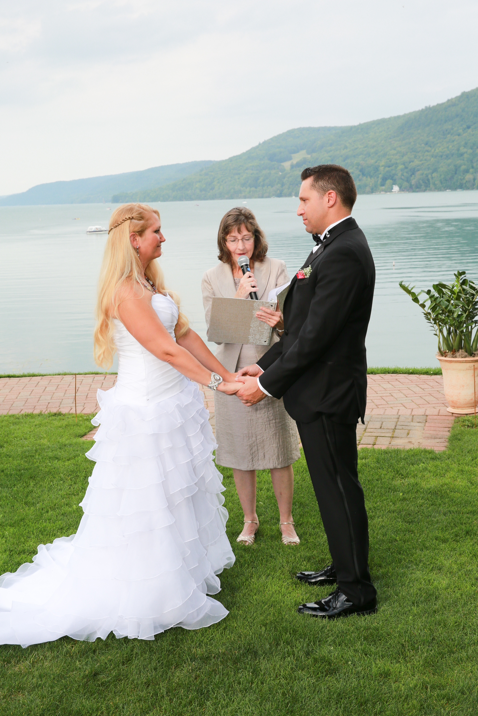 photograph of wedding vows at a lake side summer wedding.