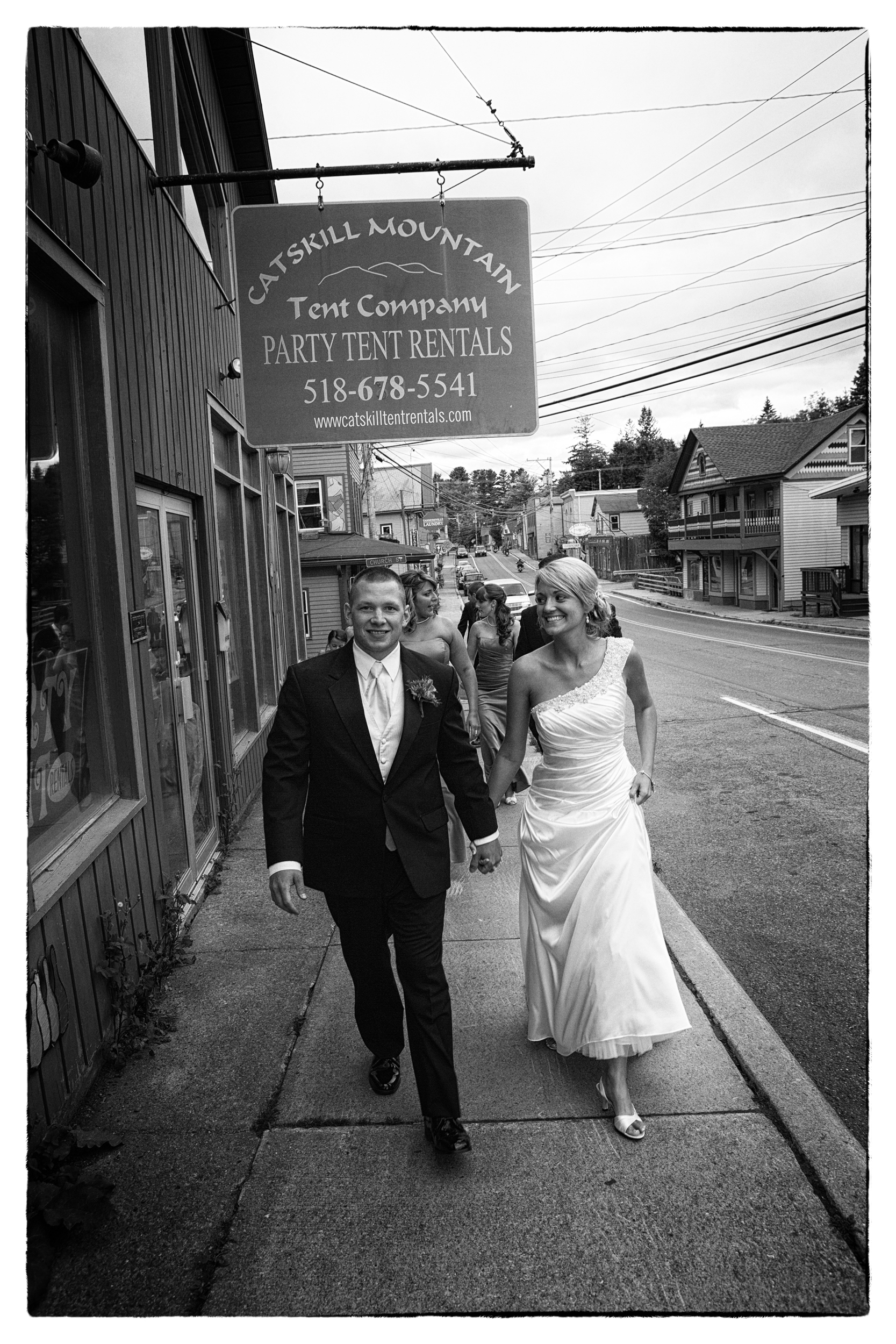 Bride and groom walking the streets of Hunter, NY