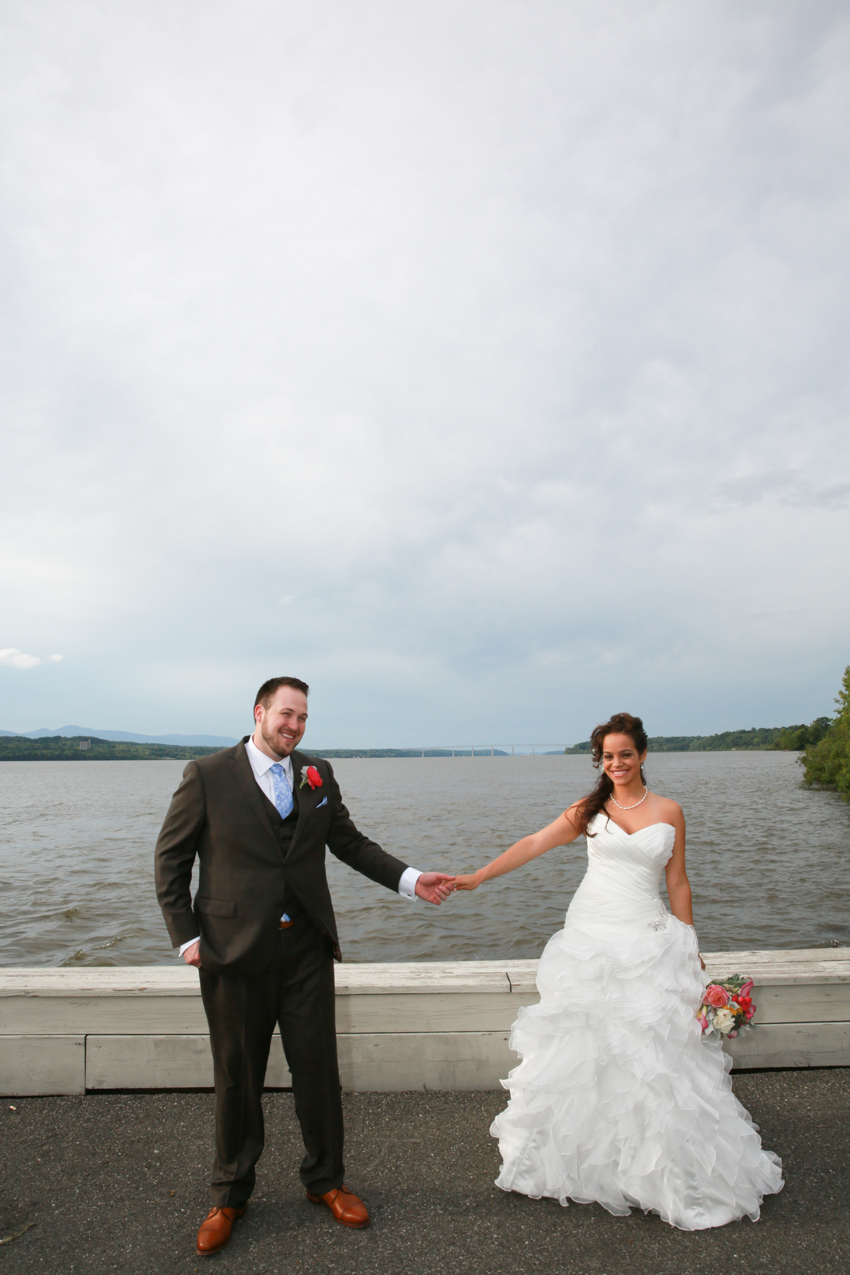 Bride and Groom holding hands at the Hudson River