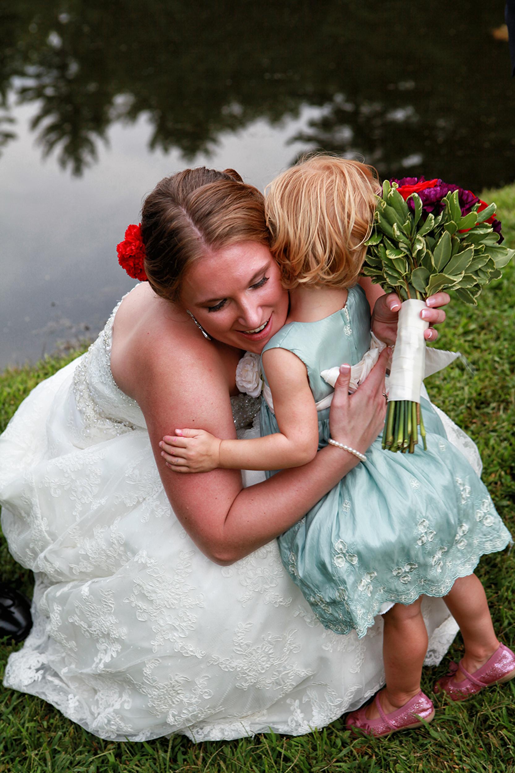 Bride hugging niece in Kingston