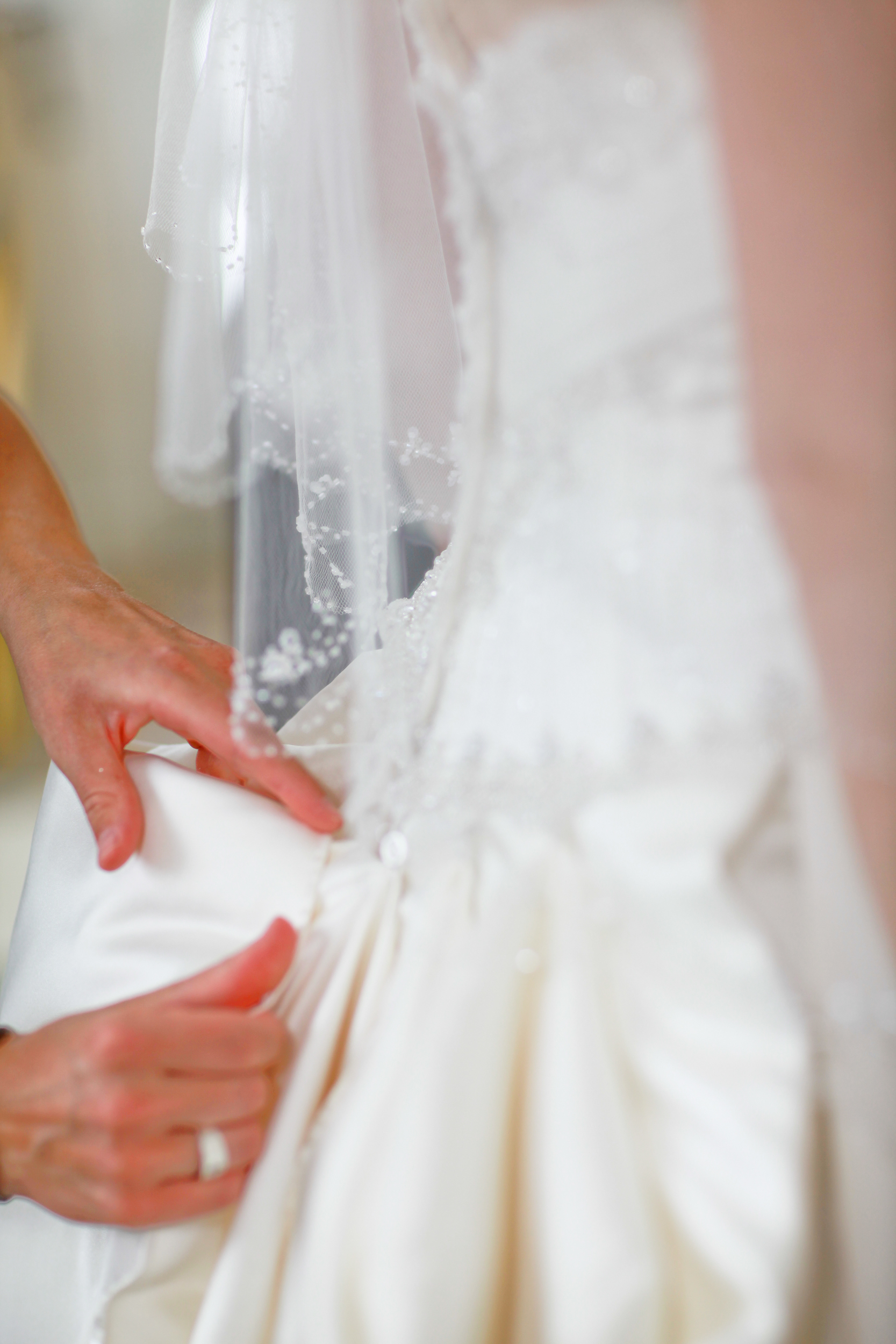 Mother fixing dress before wedding