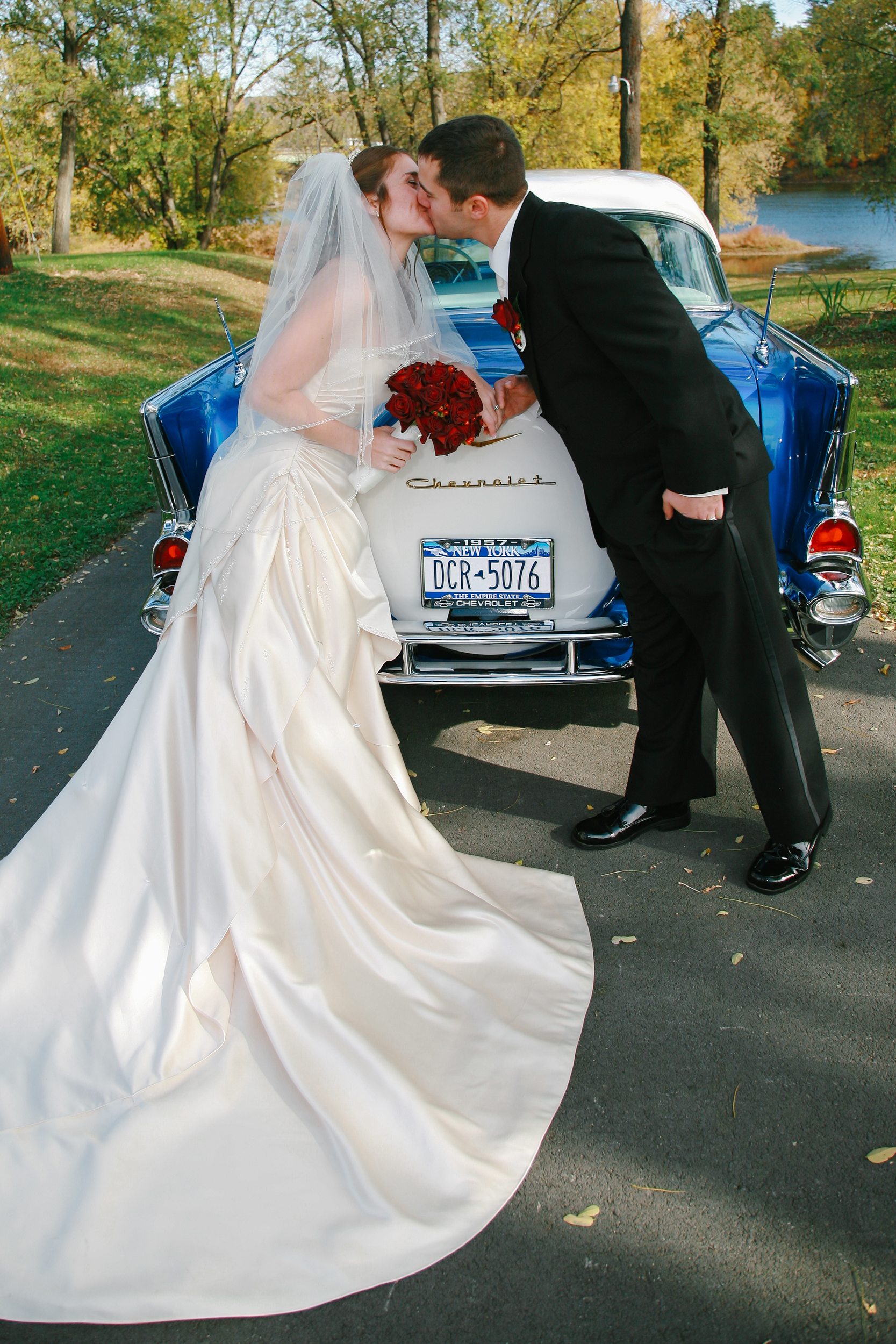 Bride and Groom with a 1957 Chevy at the Wedding