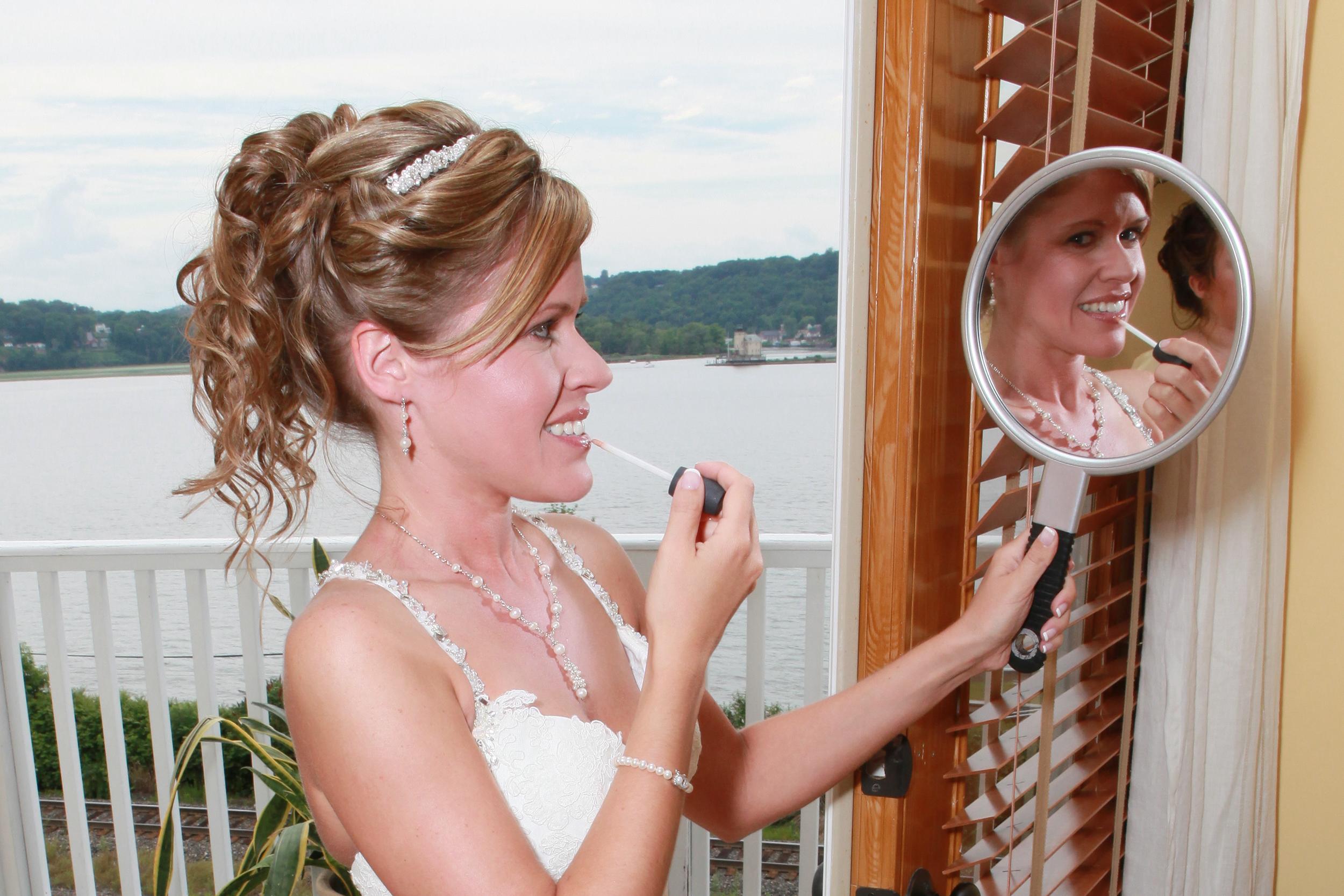 Bride looking at a hand mirror