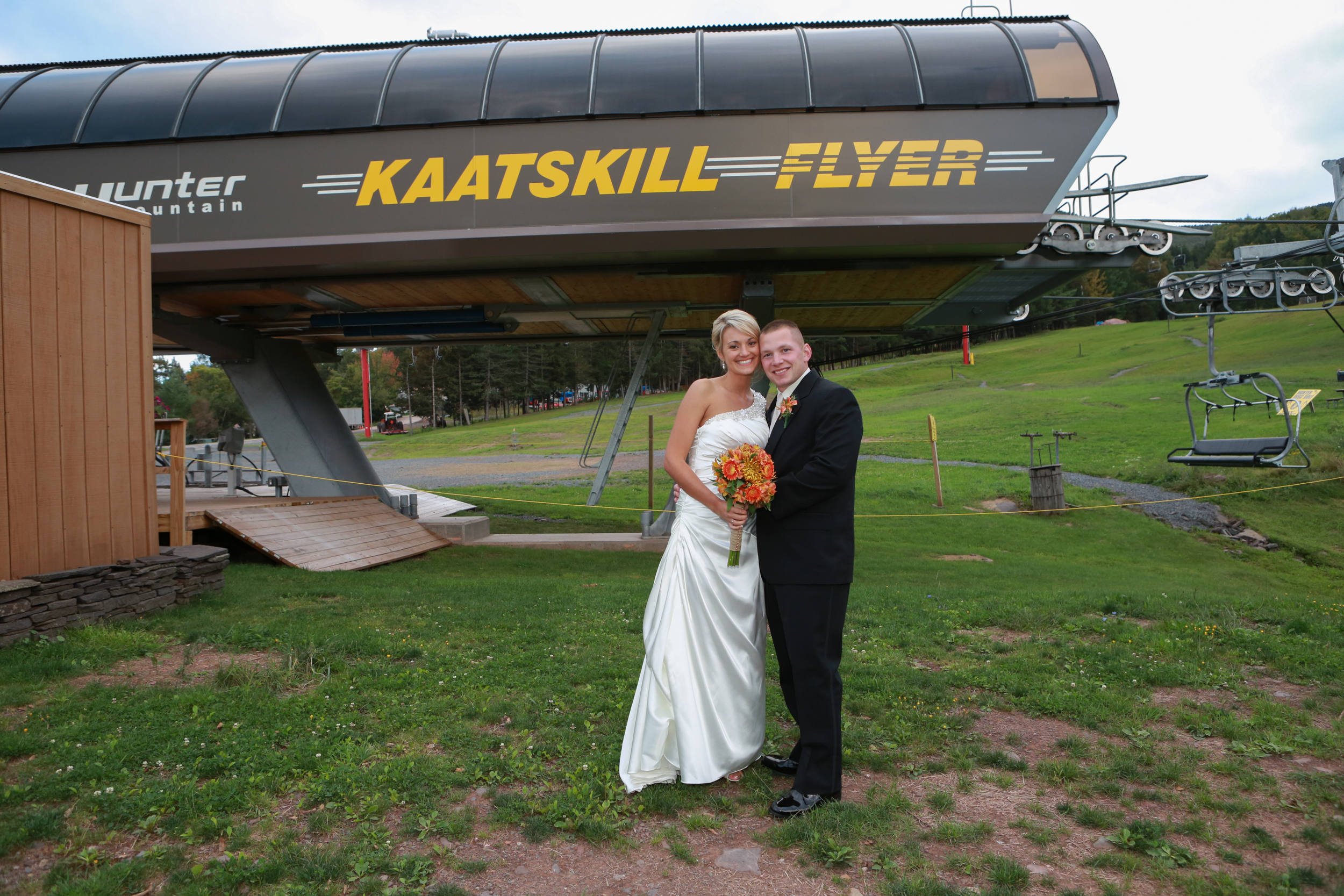 Wedding photo in front of the Kaatskill Flyer