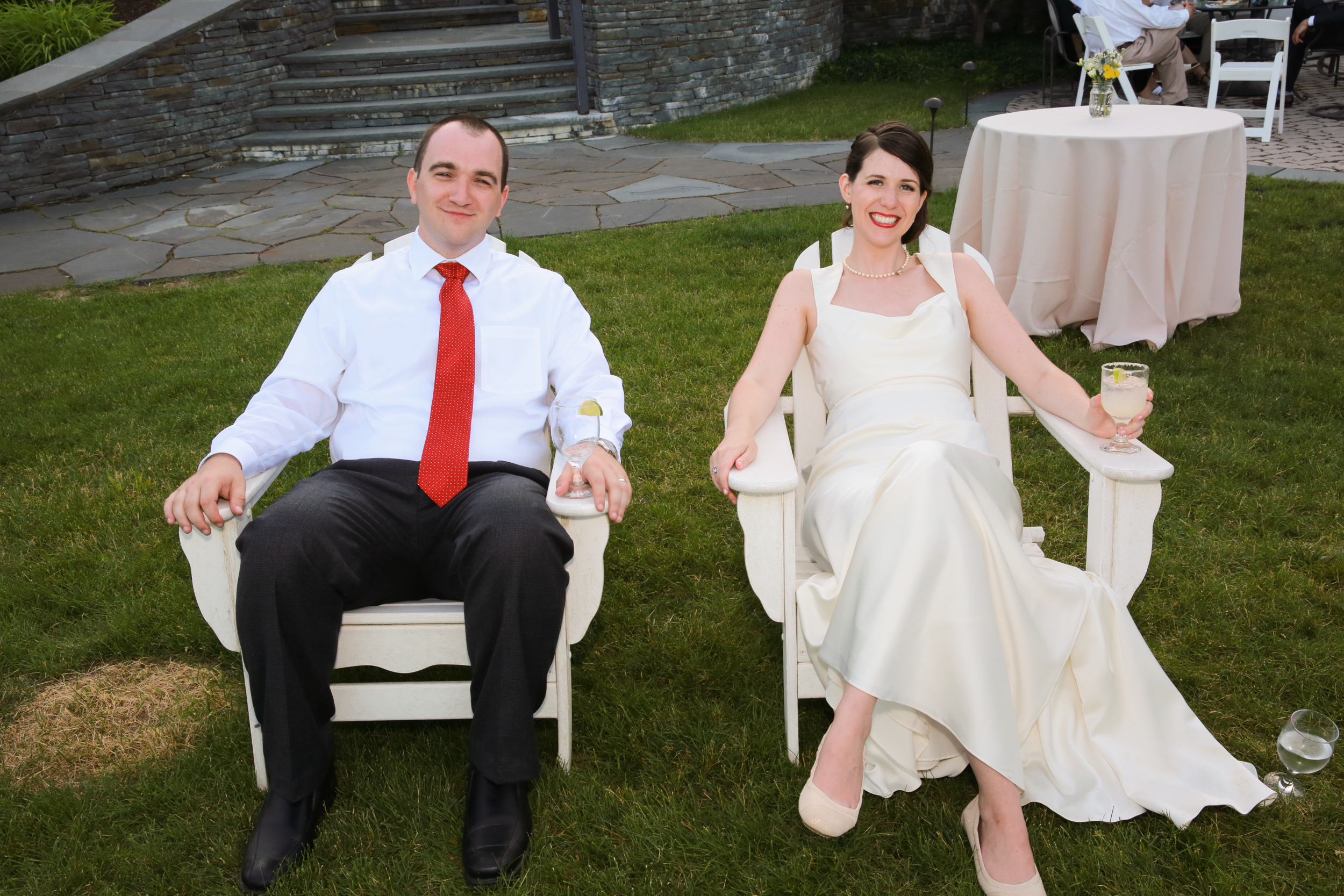 Photo of Bride and Groom Relaxing on Lawn Chairs