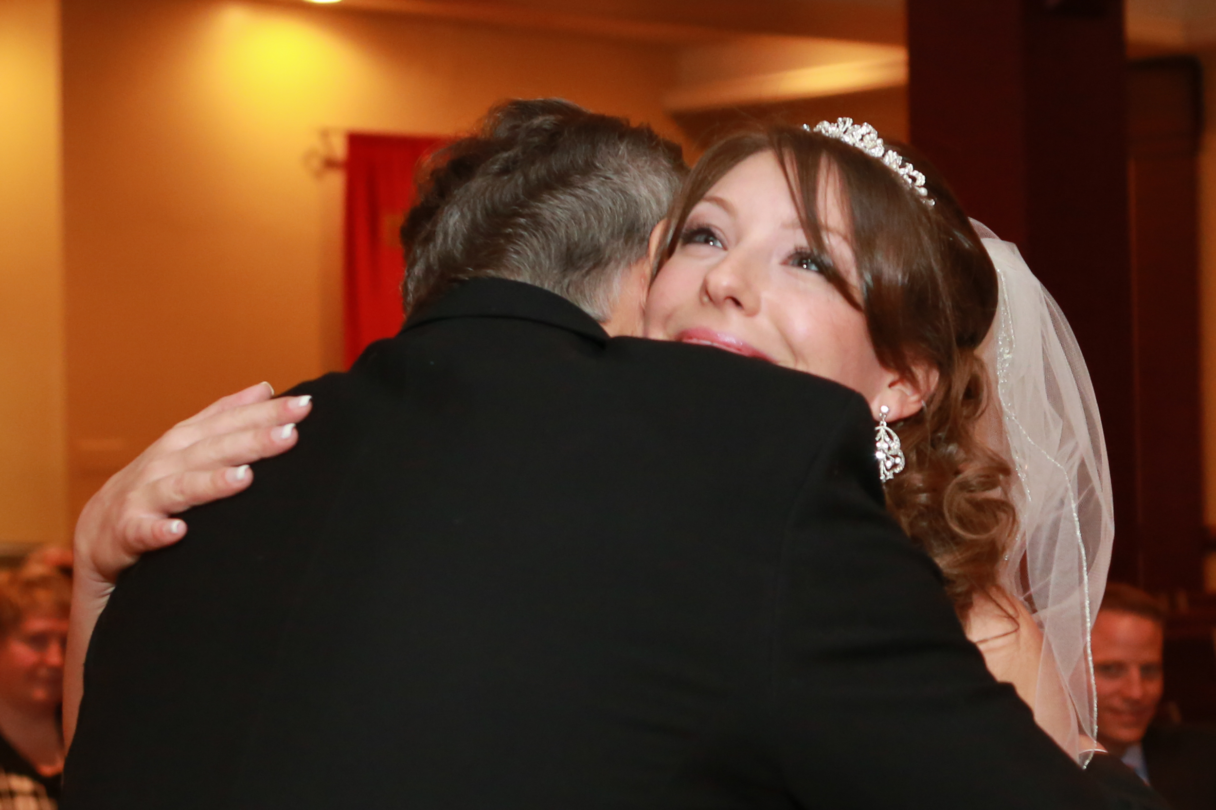 Photo of father hugging daughter right before wedding