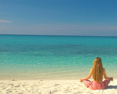 woman_meditating_beach_cropped.jpg
