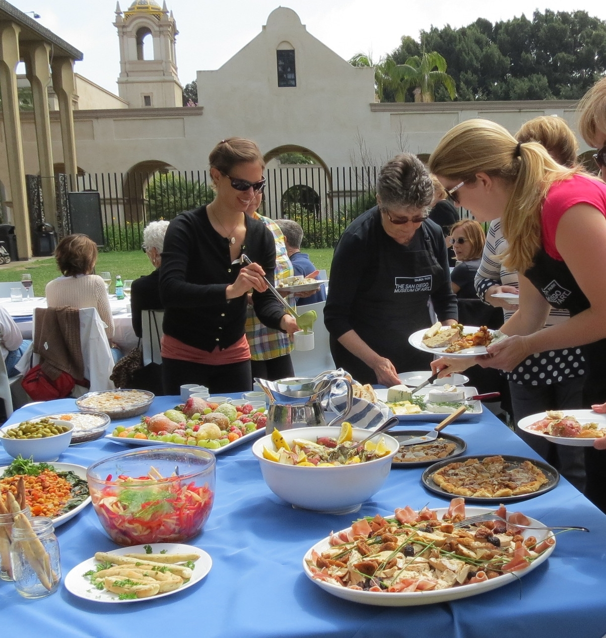 Artful Cooking: A French Impressionist Picnic at the San Diego Museum of Art (Carol's daughter, Amanda, at left, helping guests)