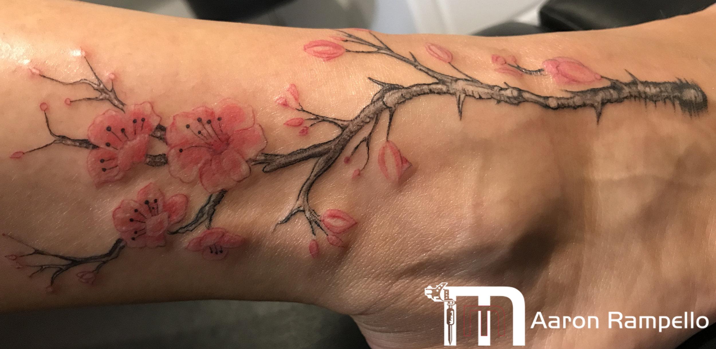 cherry blossom foot tattoo masters method.jpg